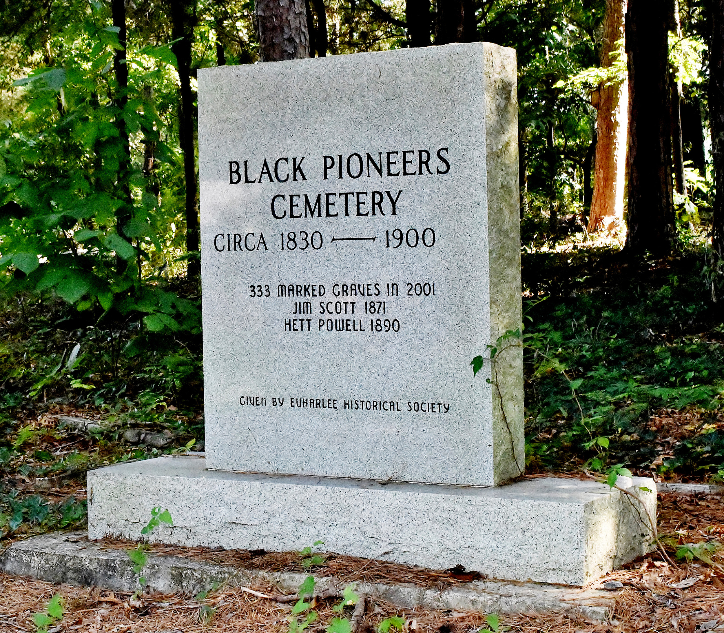 A monument on the edge of the Black Pioneers Cemetery facing Covered Bridge Road memorializes the Euharlee landmark.