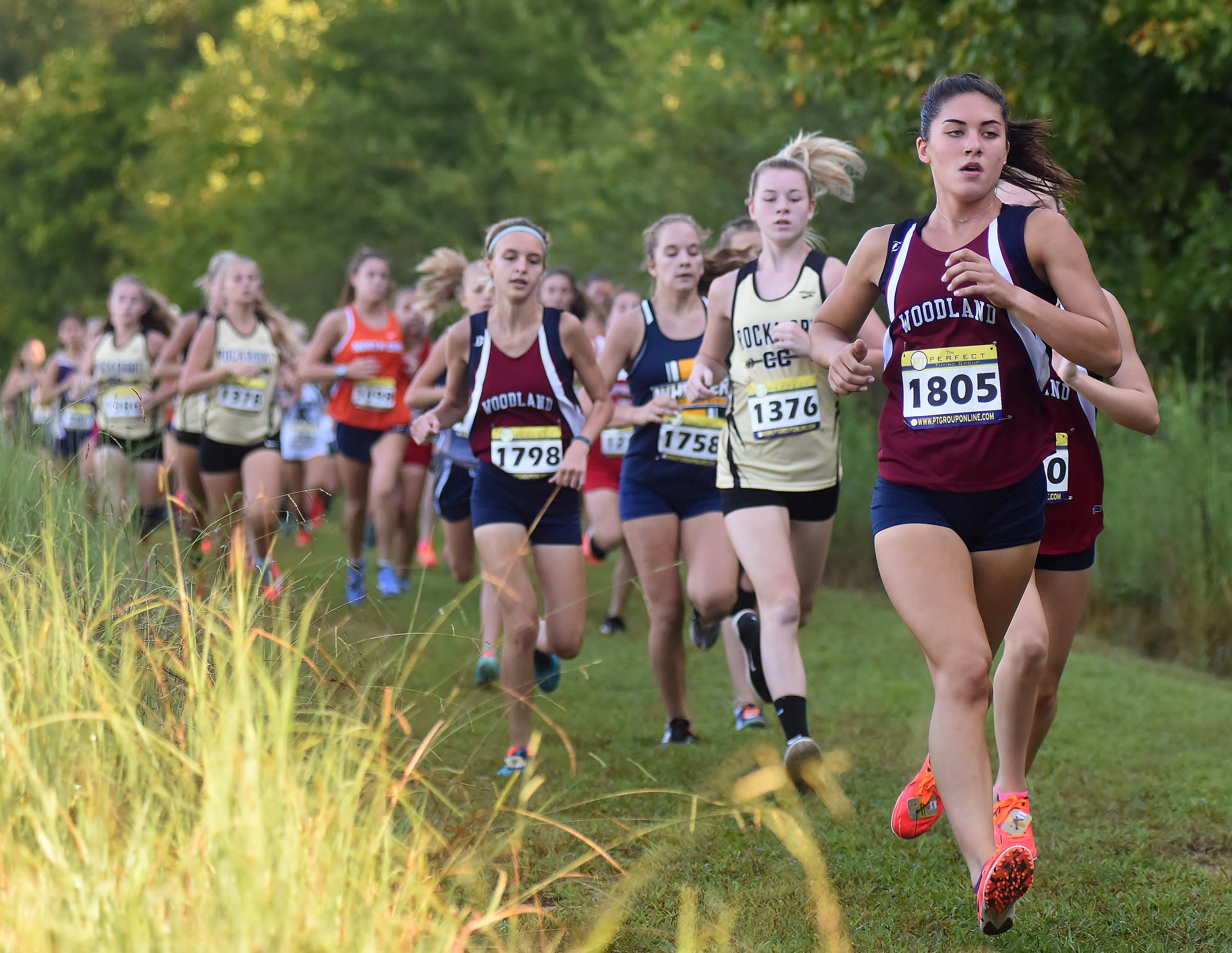 Woodland's McKenna Trapheagen leads the pack during Saturday's Run at the Rock hosted by the Wildcats. Trapheagen won the event in convincing fashion, finishing 52 seconds ahead of her teammate and second-place finisher Carli Clymer.