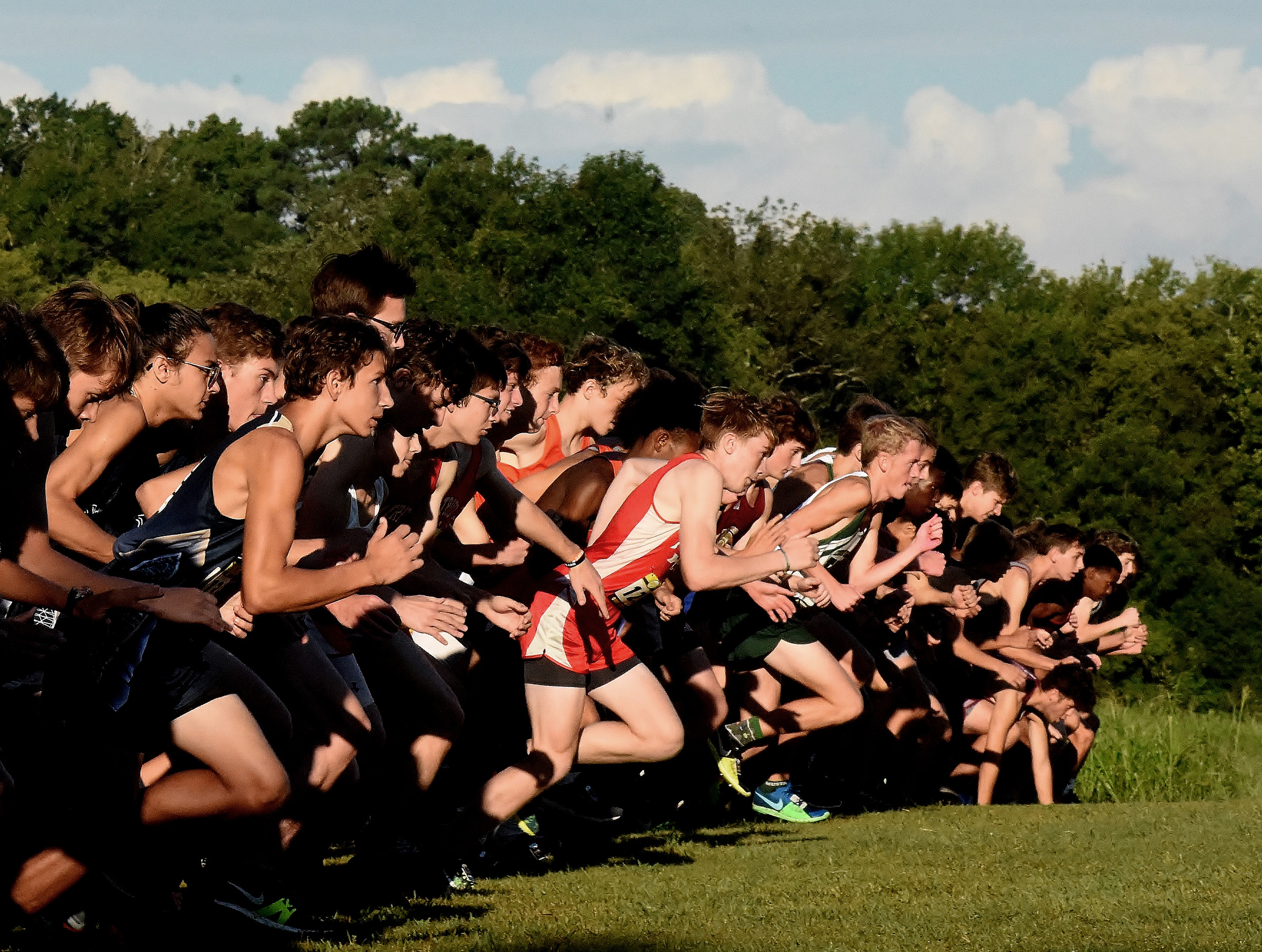 Runners take off at the start of the boys race during Saturday's Run at the Rock.