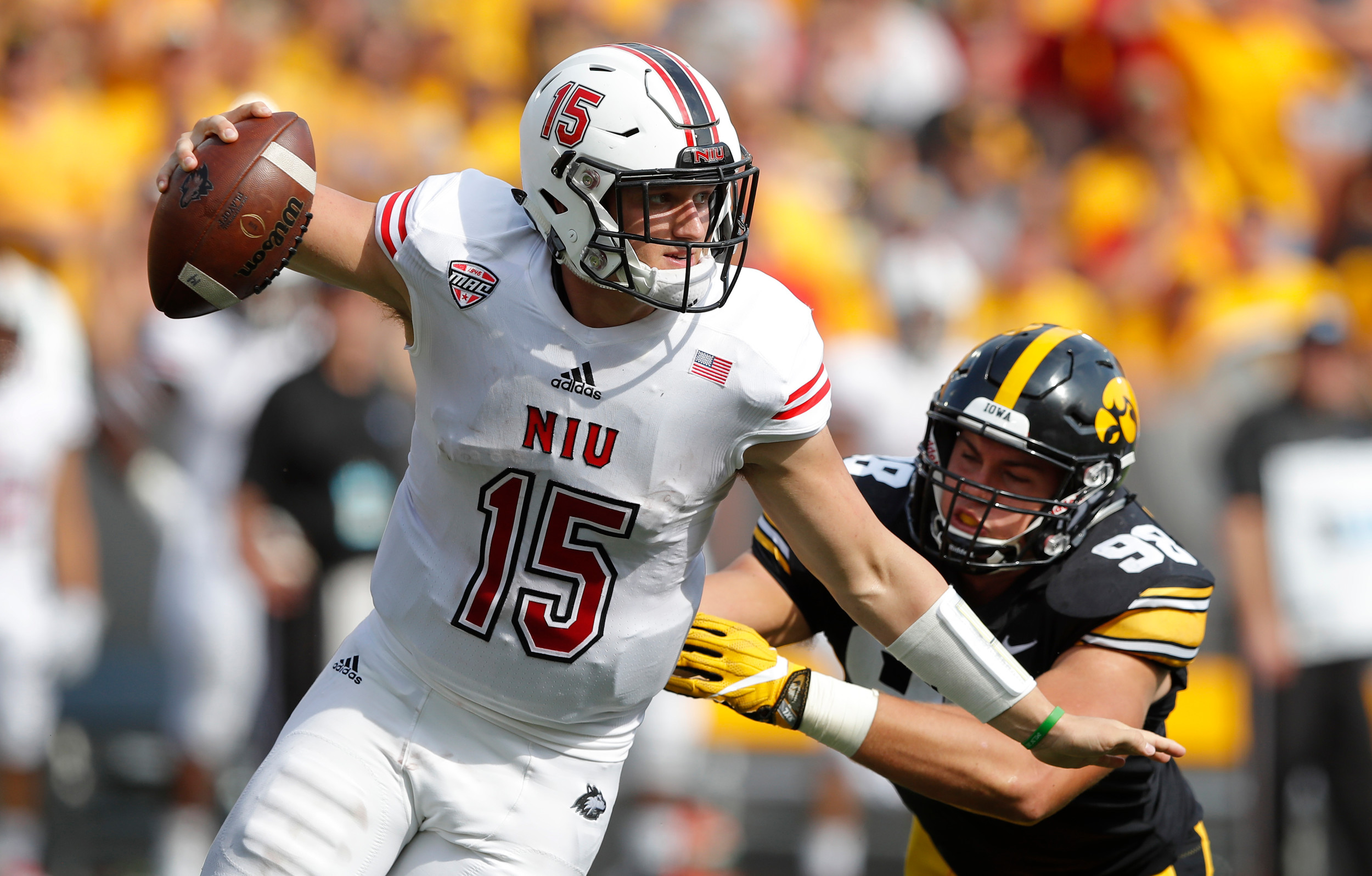 Northern Illinois quarterback Marcus Childers looks to avoid the pass rush of Iowa during Saturday's game in Iowa City. Childers, an Adairsville High graduate, completed 14 of 25 passes in a 33-7 loss.