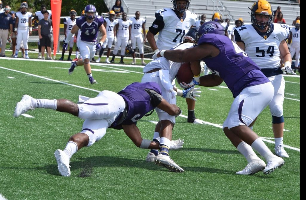 Ellsworth Community College defensive lineman Brandon Wade, right, assists on a tackle during a 17-10 loss to Highland Community College on Saturday. Wade, a Cartersville High alum, totaled three tackles in the game.