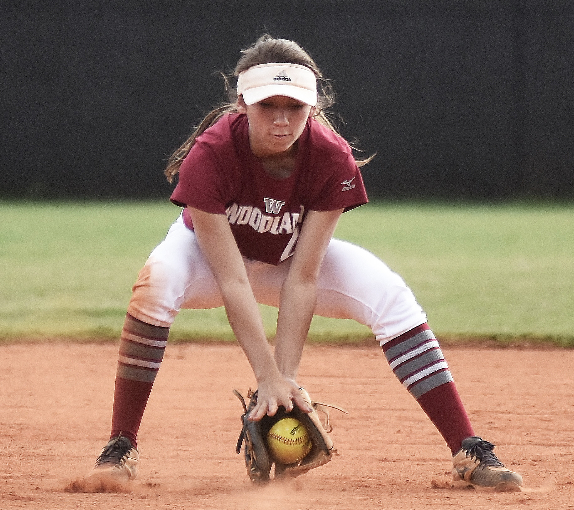 Woodland second baseman Bella Carnes fields a groundball at Hiram.