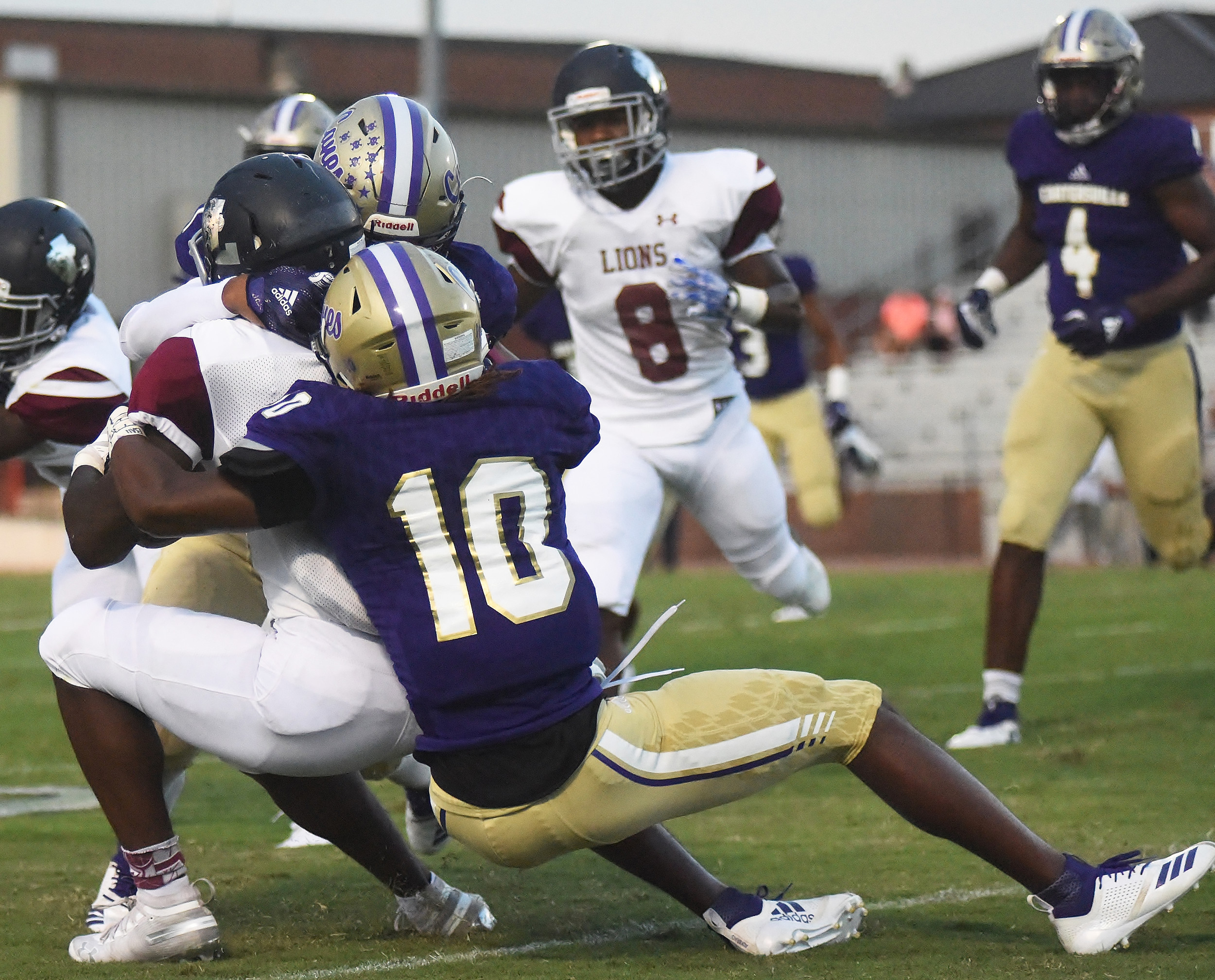 Cartersville's Sunni Moorehead (10) and Marko Dudley take down a Luella running back during last week's game at Weinman Stadium. Cartersville is one of eight teams in the state to have not allowed a touchdown so far this season, and the Canes hope to keep up the trend Friday at home against McNair.