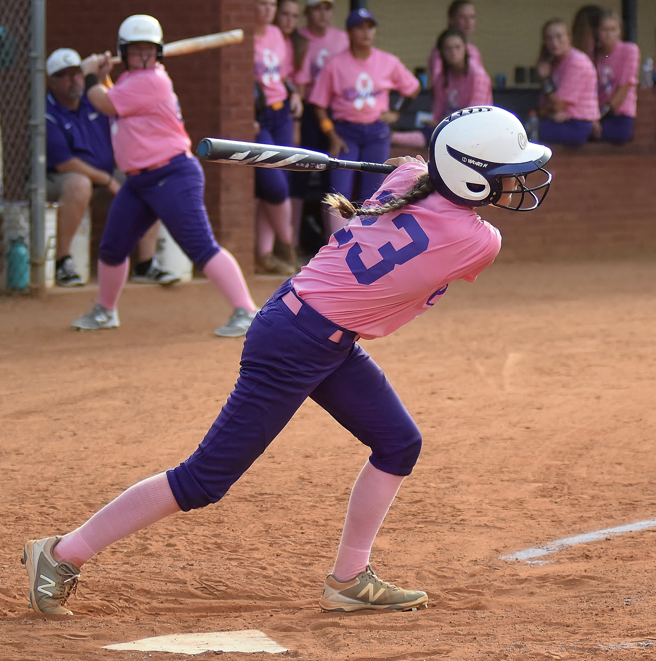 Cartersville catcher Lauren McElhaney follows through on a base hit to left field in the second inning of Thursday's 7-2 loss to Central-Carroll. McElhaney had two of the Canes' four hits, including an RBI double in the sixth inning.