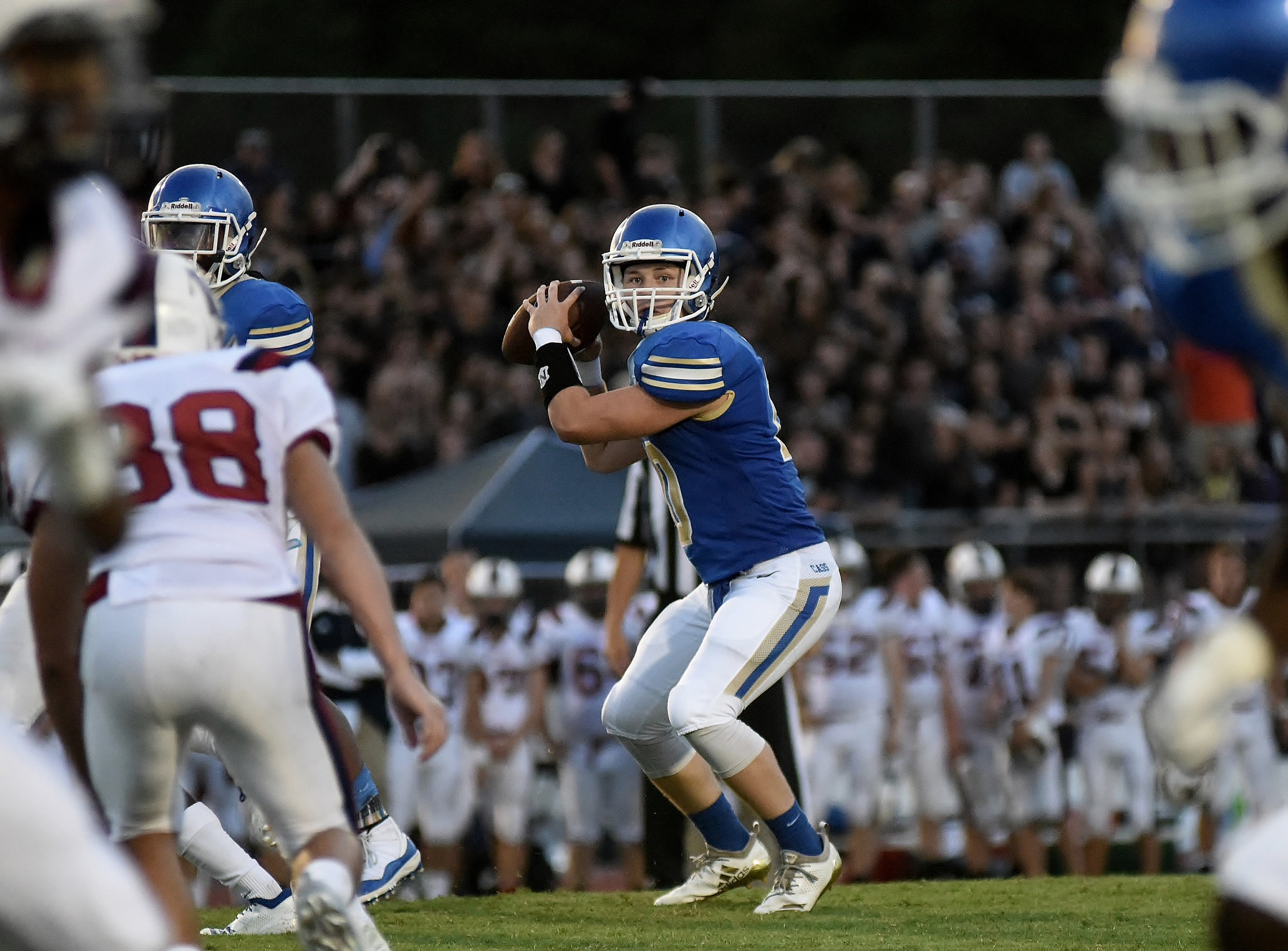 Cass quarterback Rett Moore looks to pass the ball during Friday's game.