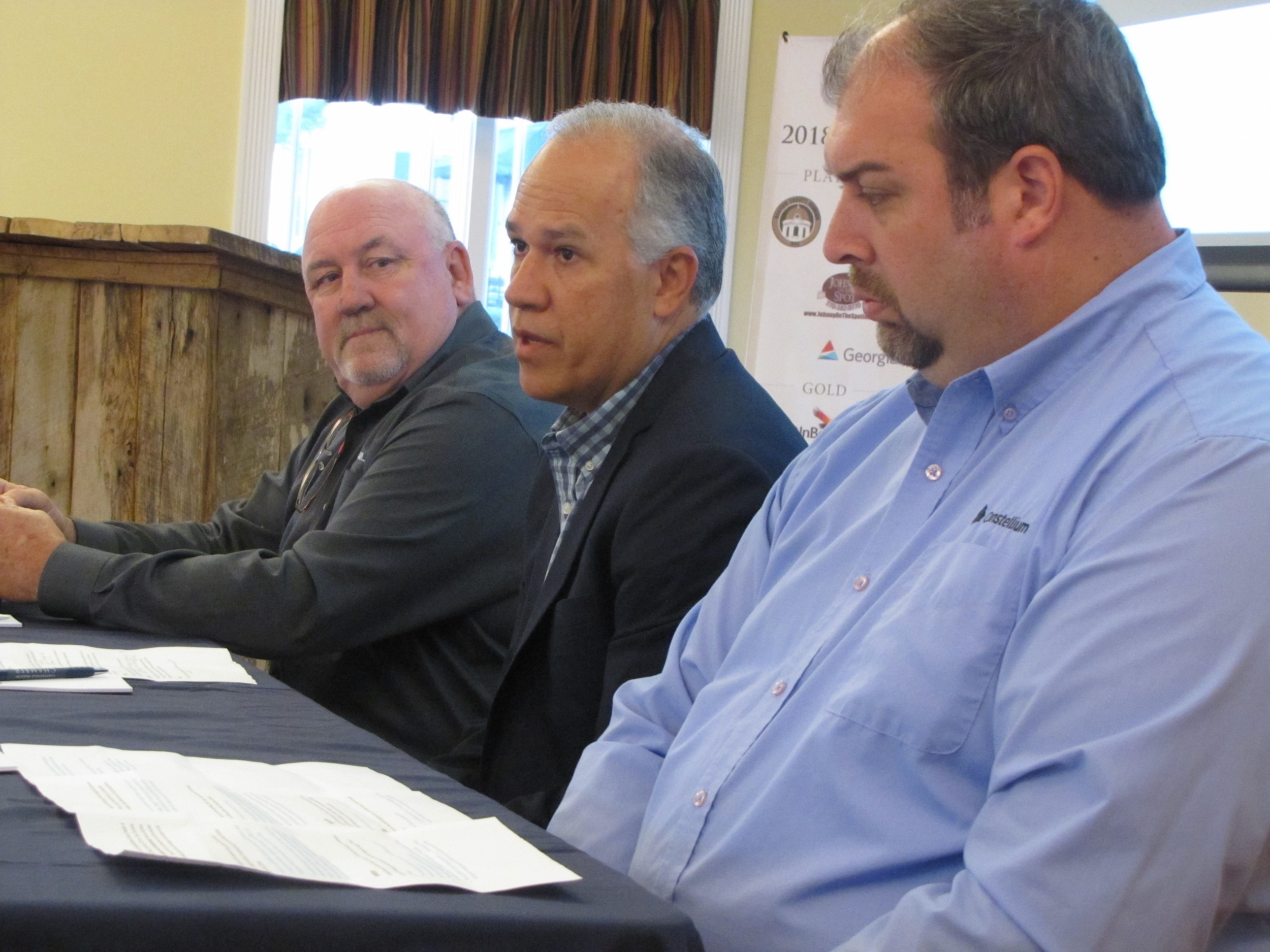 From left, TrinityRail plant manager Bob Fair, Gerdau Long Steel North America Vice President and General Manager Casimiro Liborio and Constellium Automotive plant manager Bryan James speak at Monday's Cartersville-Bartow Chamber of Commerce presentation.