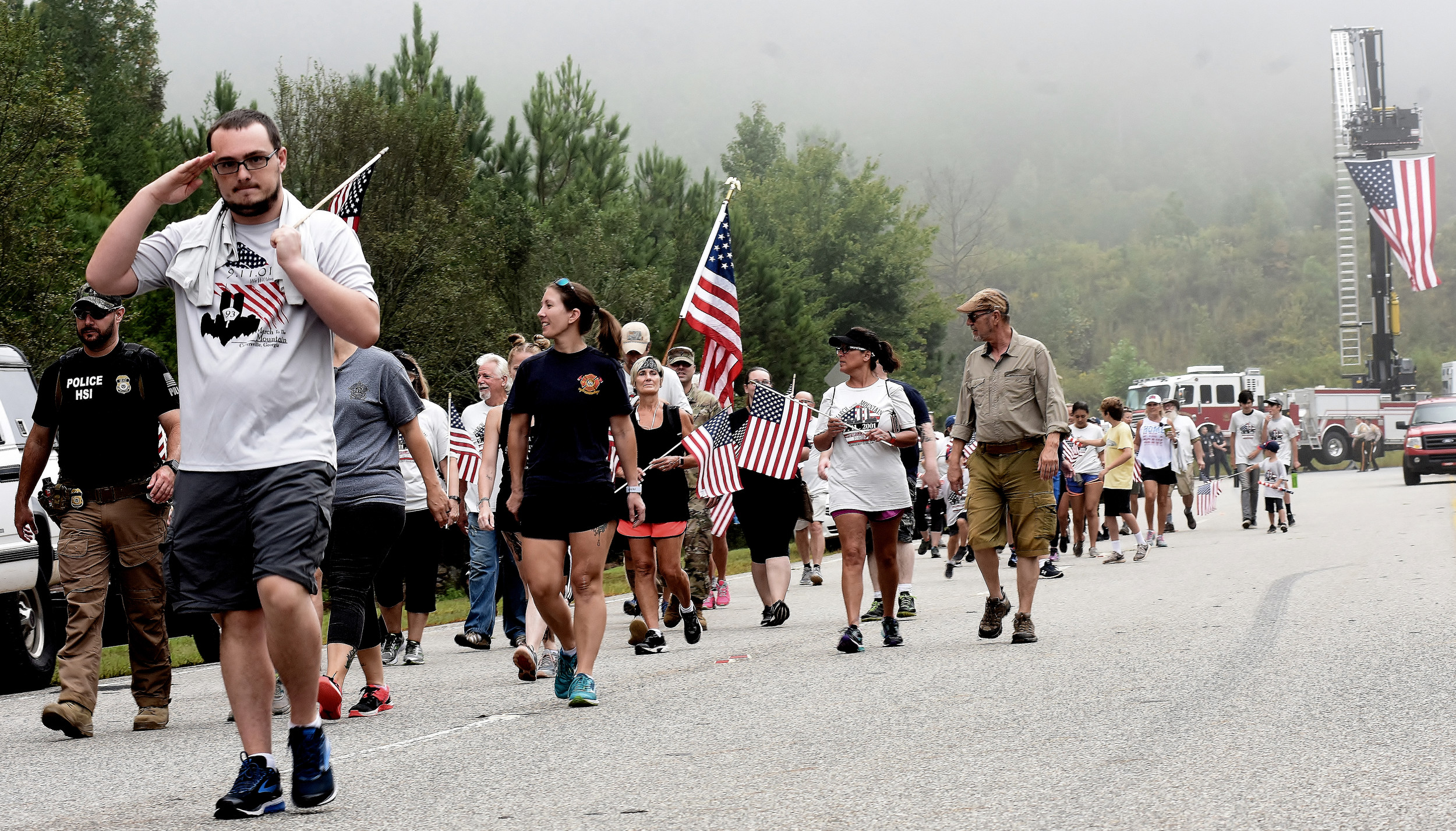 Approximately 100 men, women and children took part in the annual 9/11 March to the Mountain Tuesday morning in Cartersville. Following the national anthem, the group started the 6.5-mile loop at 9:11 a.m. from the base of Pine Mountain, which also served as the finishing point.