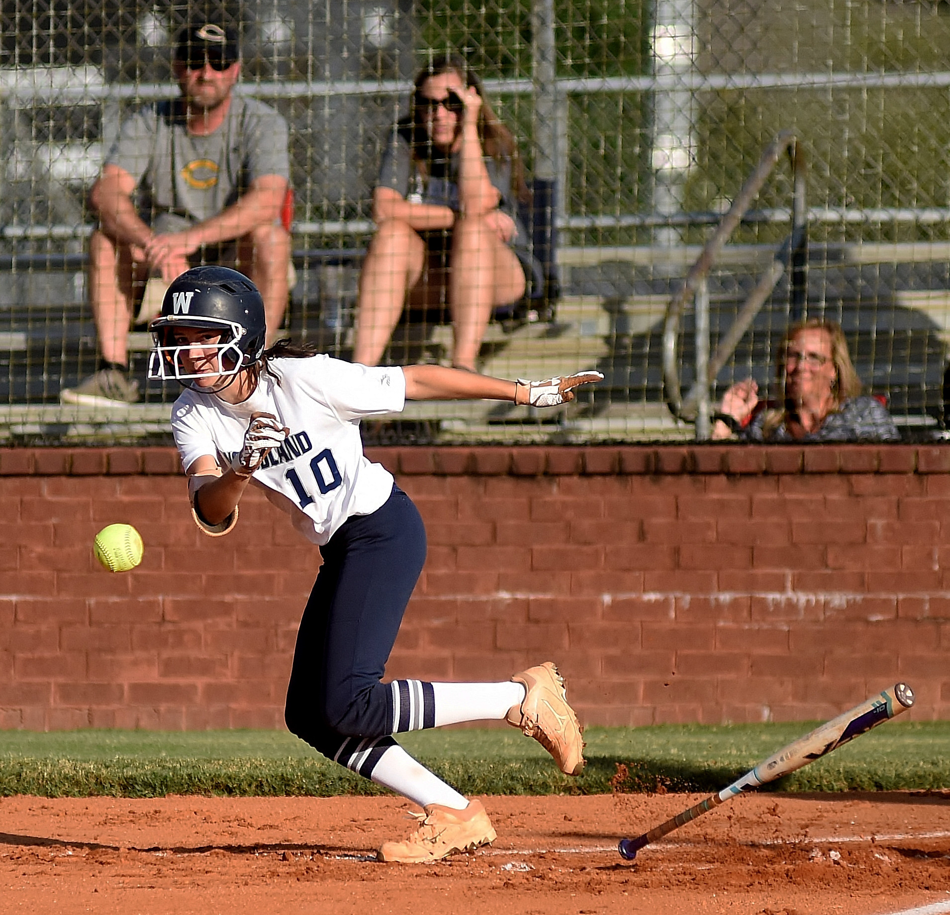 Woodland's Morgan Bailey drops a first-inning sacrifice bunt down in an eight-inning, 2-1 win at home over first-place Carrollton Tuesday.