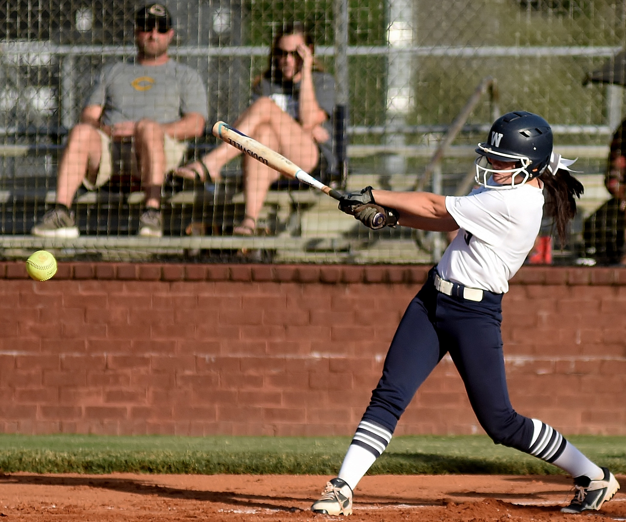 Woodland's Caroline Higdon hits a first-inning, two-out RBI single in an eight-inning, 2-1 win at home over first-place Carrollton Tuesday.