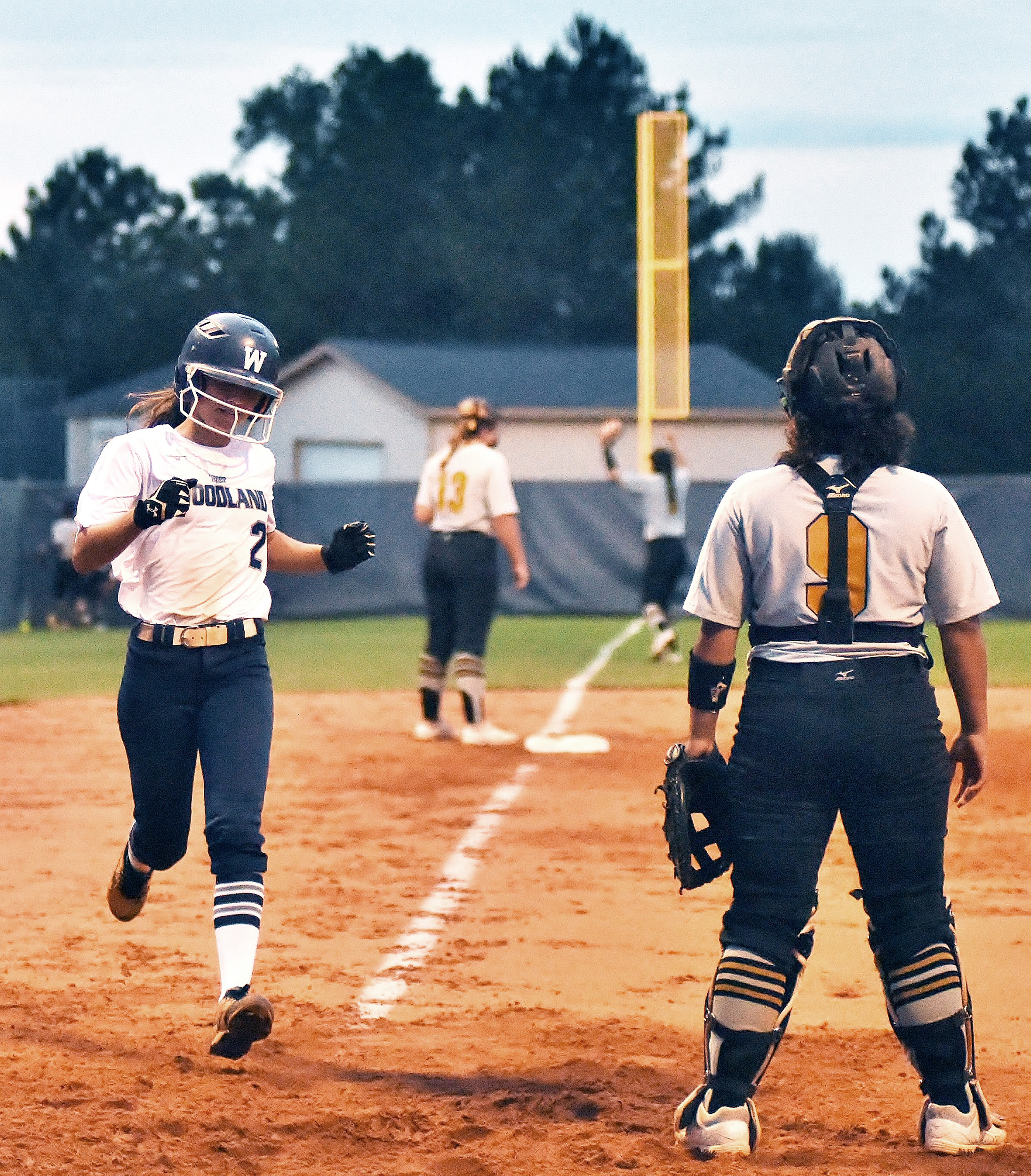 When Woodland's Morgan Bailey tripled to the left field corner, Bella Carnes came around from first base to score the walk-off run in the eight-inning, 2-1 win at home over first-place Carrollton Tuesday.