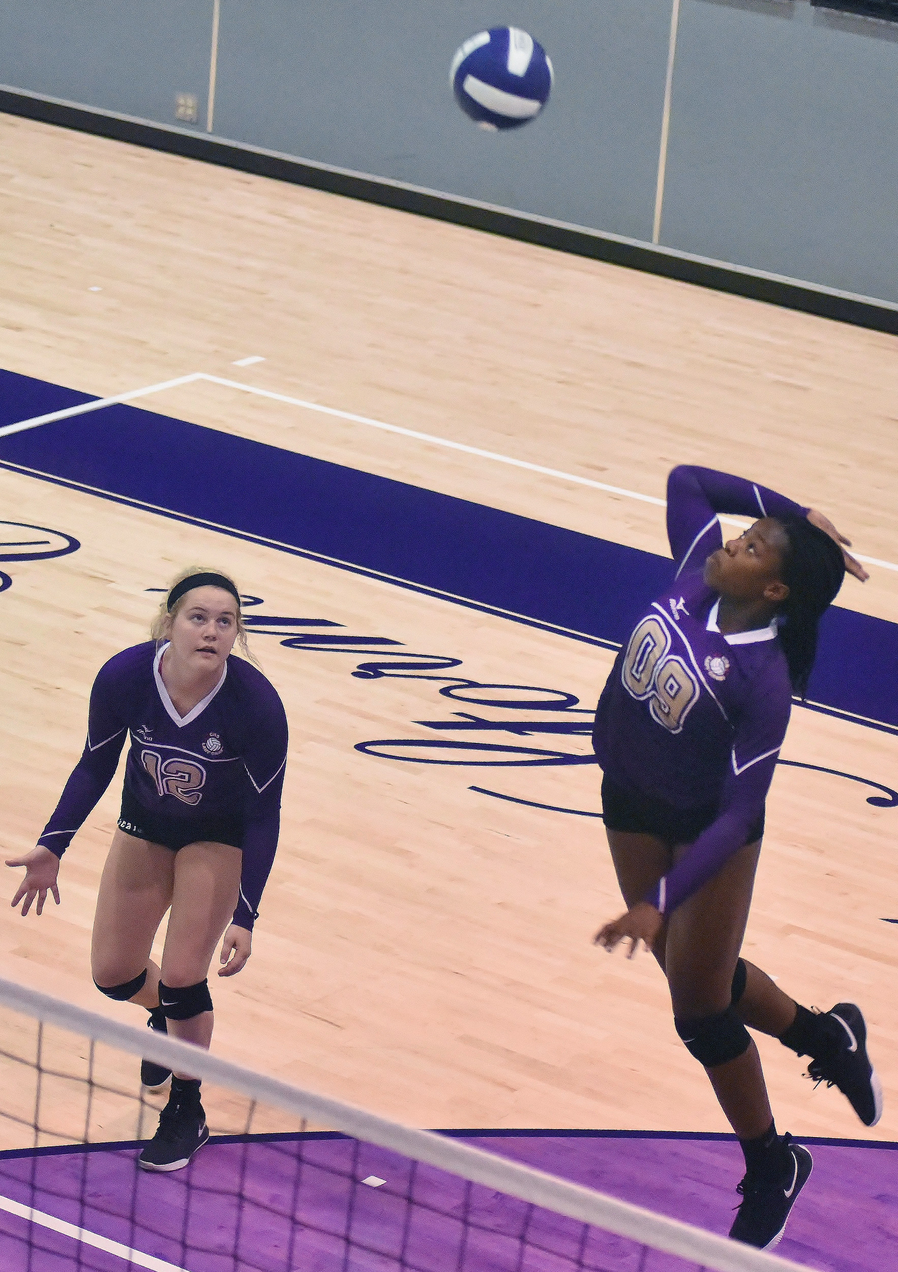 Cartersville's Nedu Evans prepares to spike the ball against Chapel Hill, as teammate Rebekah Stevens looks on, during Tuesday's tri-match at The Storm Center. The Canes defeated Chapel Hill and Troup County in straight sets.