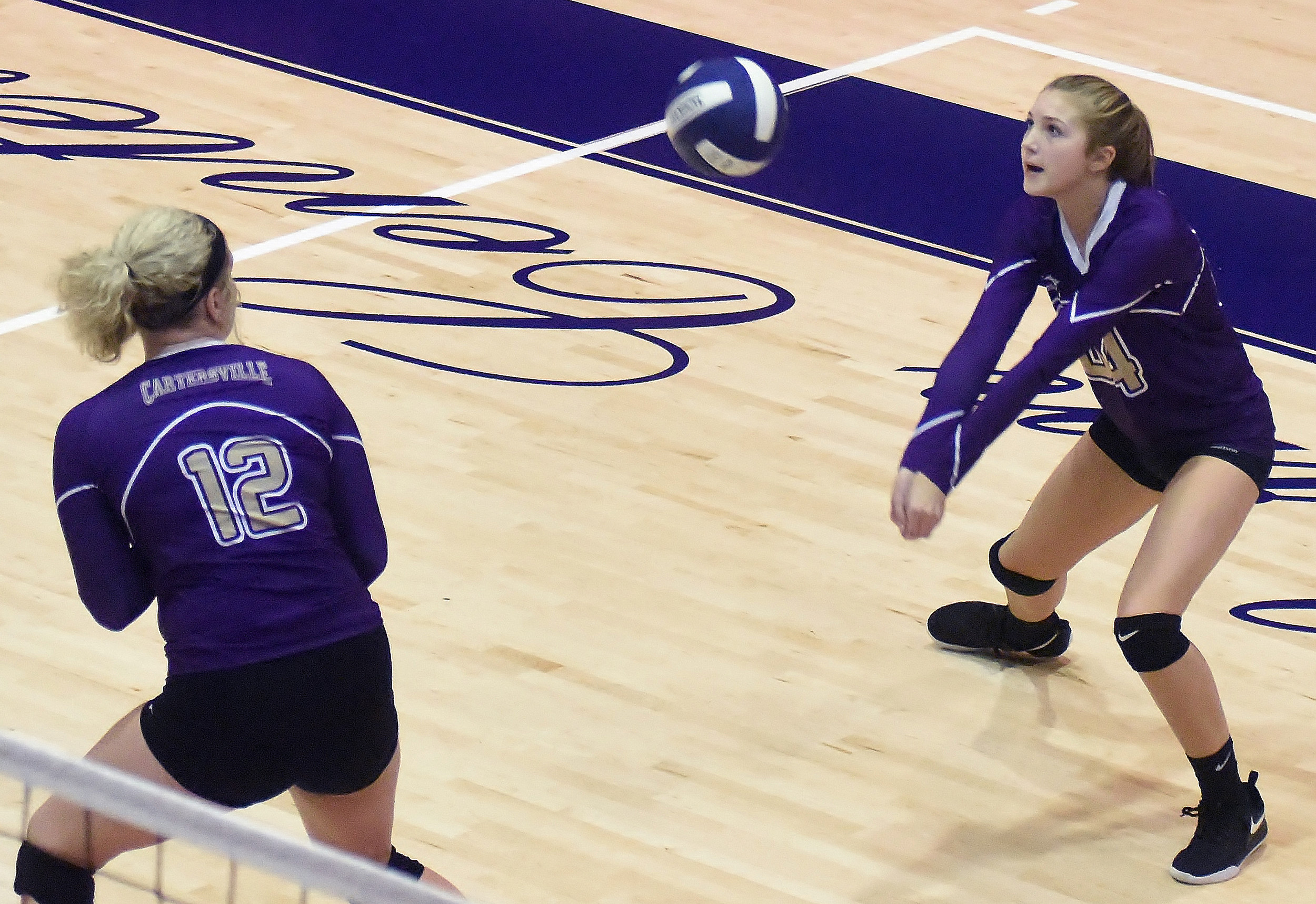 Cartersville's Halle Matthews digs the ball, as Rebekah Stevens looks on, during Tuesday's match against Chapel Hill. The Canes won the match in two sets, and the team also swept Troup County during the tri-match.