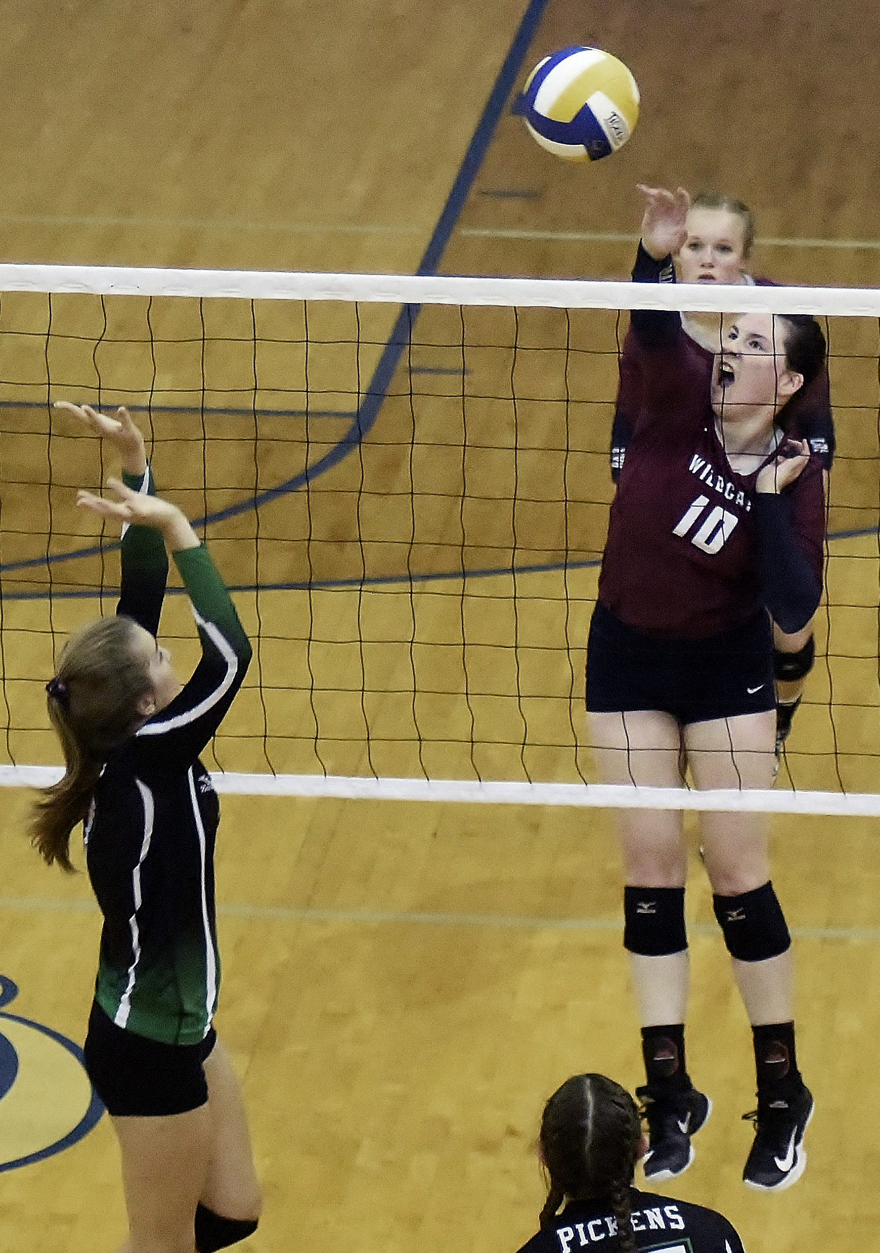 Woodland senior Emmaline Payne goes for the kill against Pickens during Thursday's tri-match at Cass High.