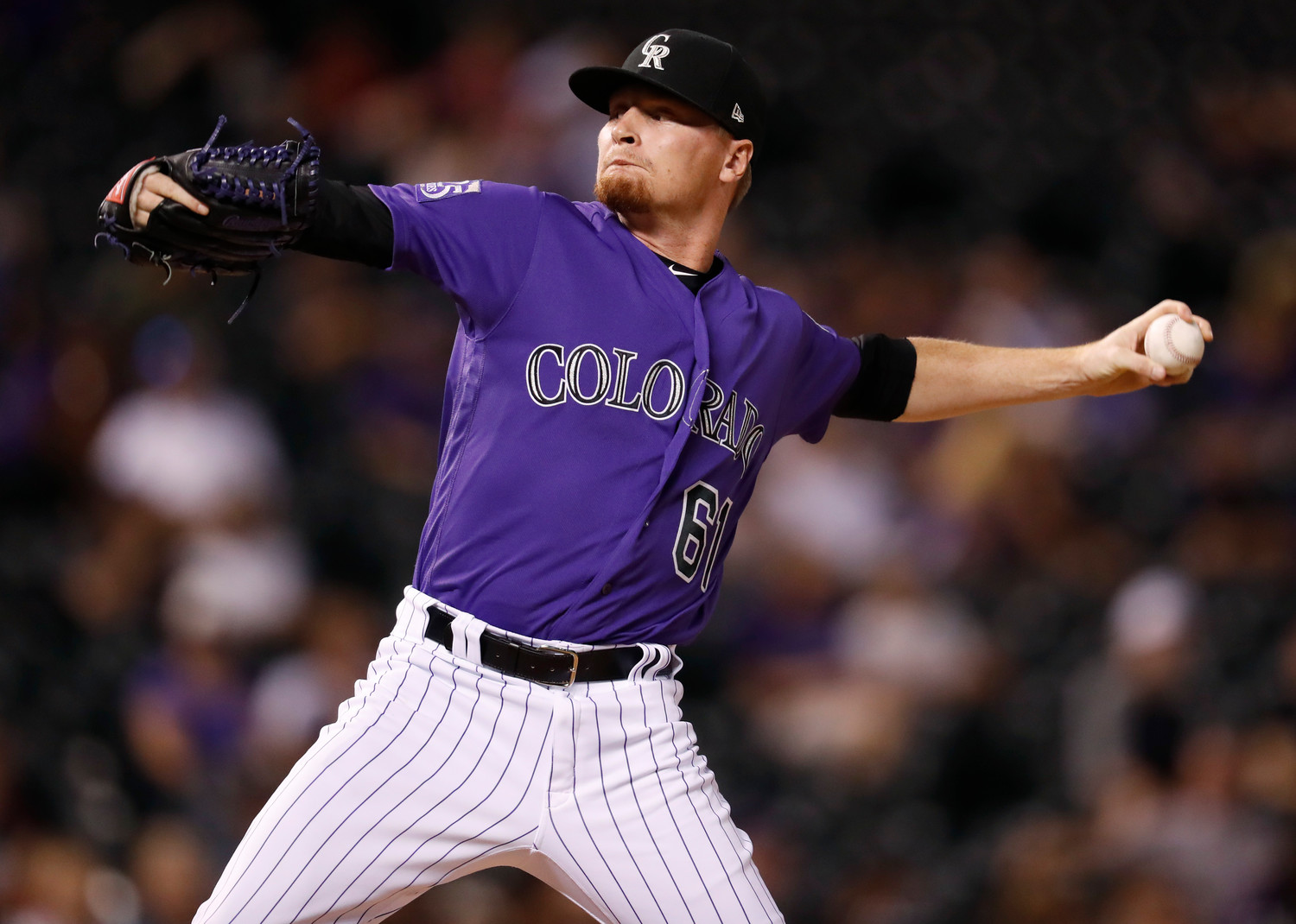 Howard returns for Rockies' playoff chase