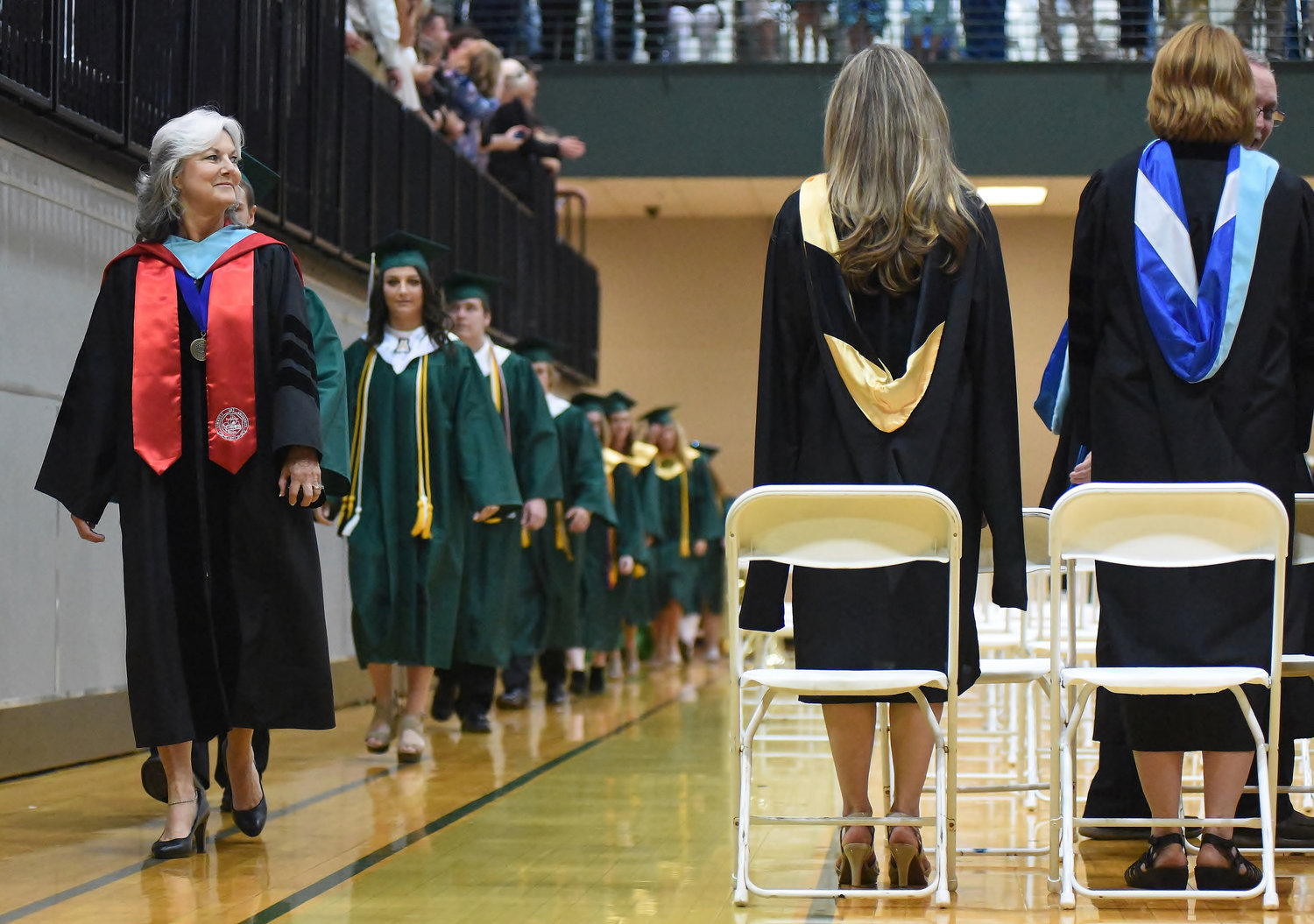 Adairsville High Associate Principal Dr. Venita Bruton leads the Class of 2018 during its graduation ceremony in May. AHS saw a 7.2 percent increase in its graduation rate over last year, the biggest increase of any school in the county.