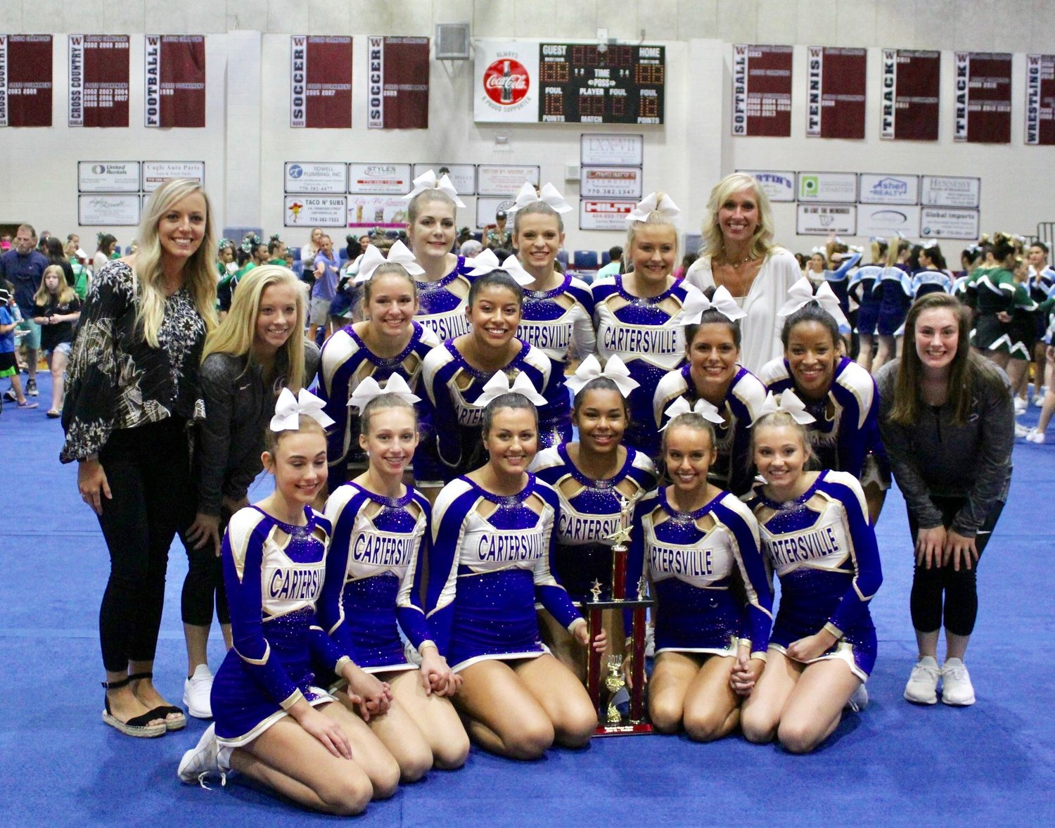 The Cartersville cheer squad poses for a photo after winning first place in the Class 4A division of Saturday's competition at Woodland High. It's the second win in as many competitions for the Canes.