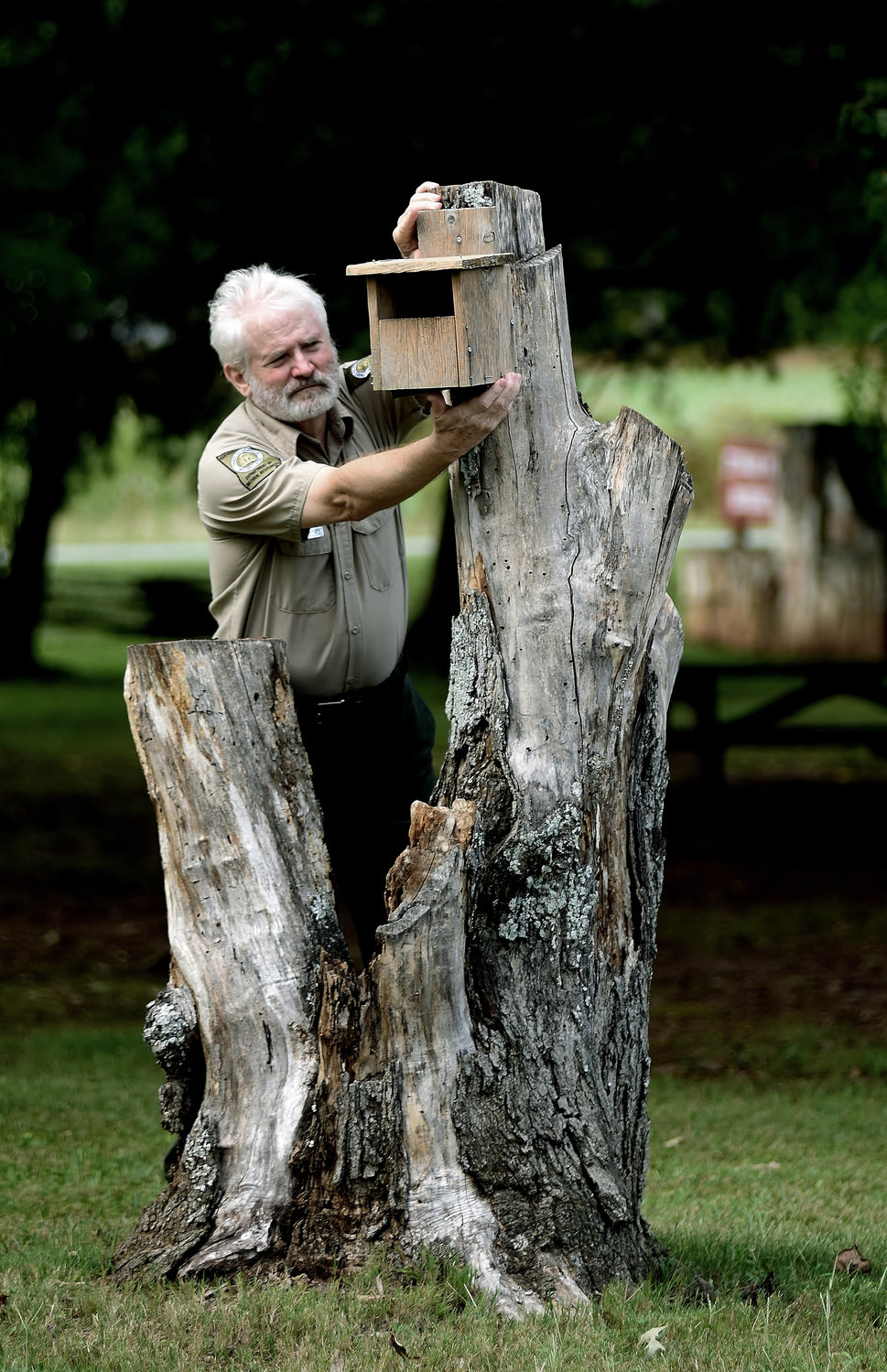 Georgia Department of Natural Resources Site Manager Steve Hadley checks one of the many birdhouses at the Etowah Indian Mounds State Historic Site. The public will have the opportunity to build birdhouses and picnic tables at the venue Saturday on Your State Parks Day.