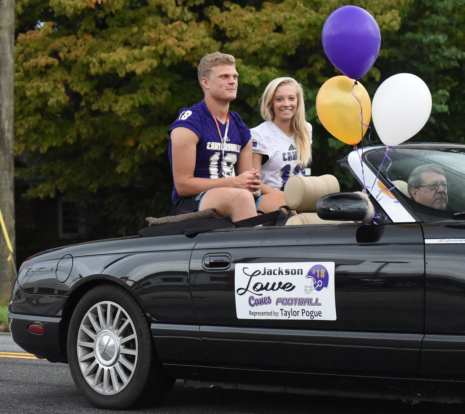 Jackson Lowe and Taylor Pogue proudly represent their school during the parade.