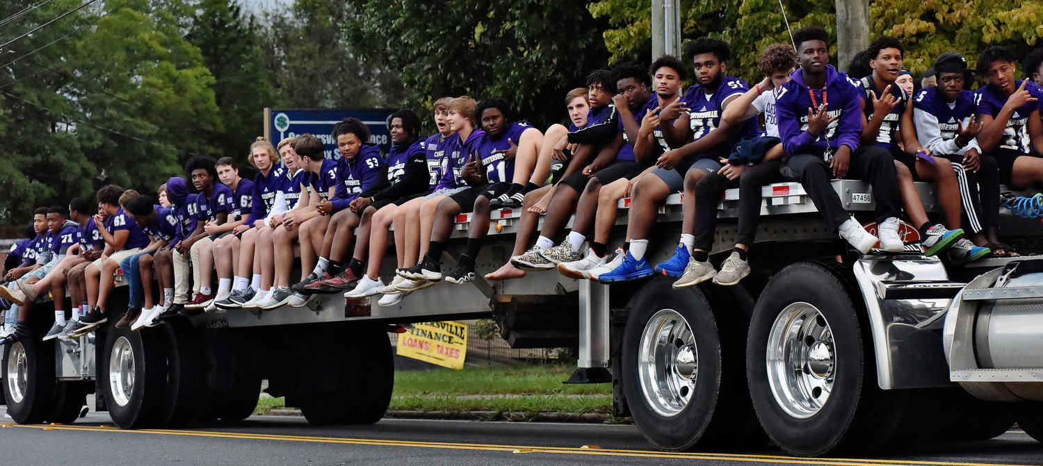 Members of the Cartersville High School football team ride in the 2018 Homecoming Parade.