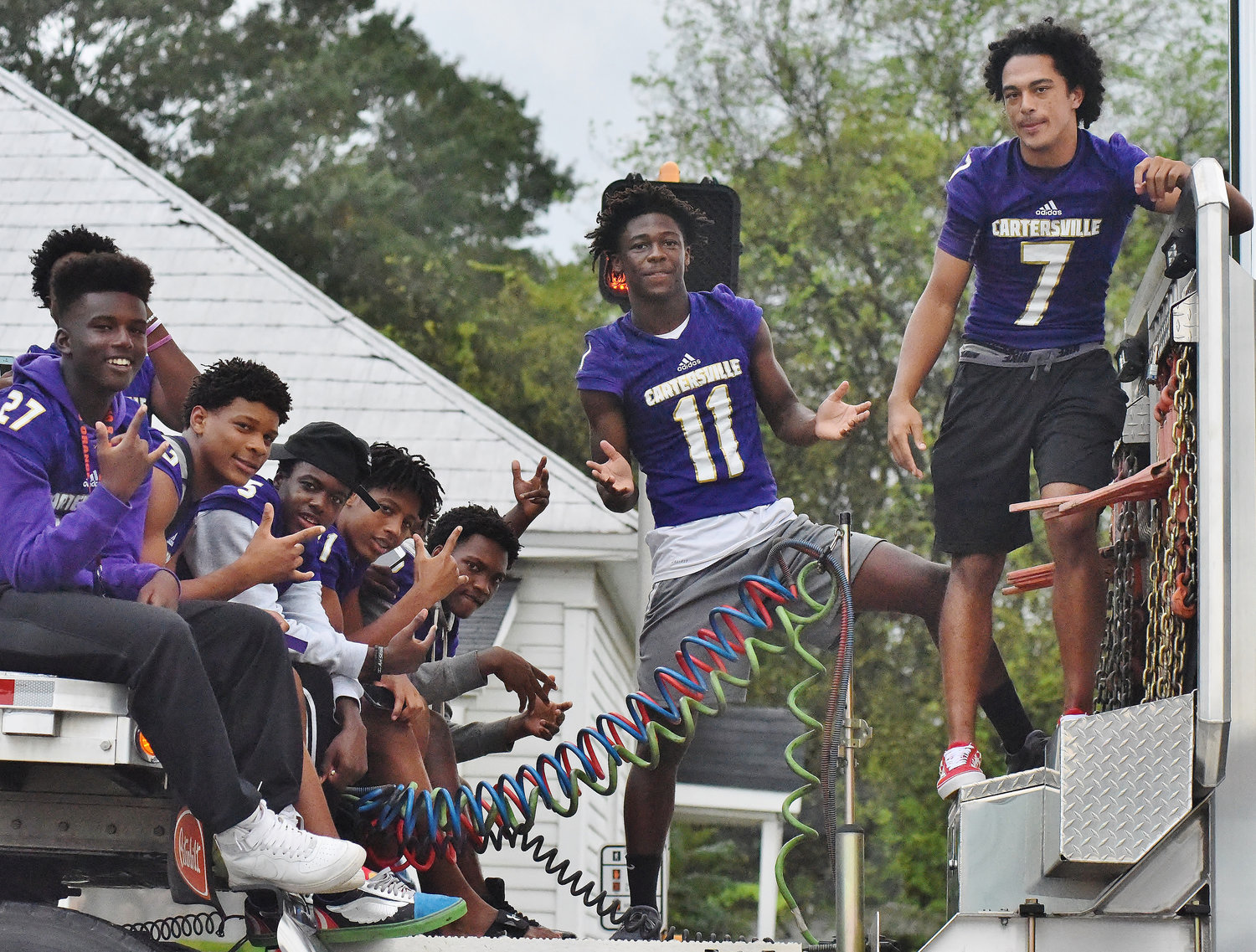 Cartersville High School football players enjoy the ride during the 2018 Homecoming Parade.
