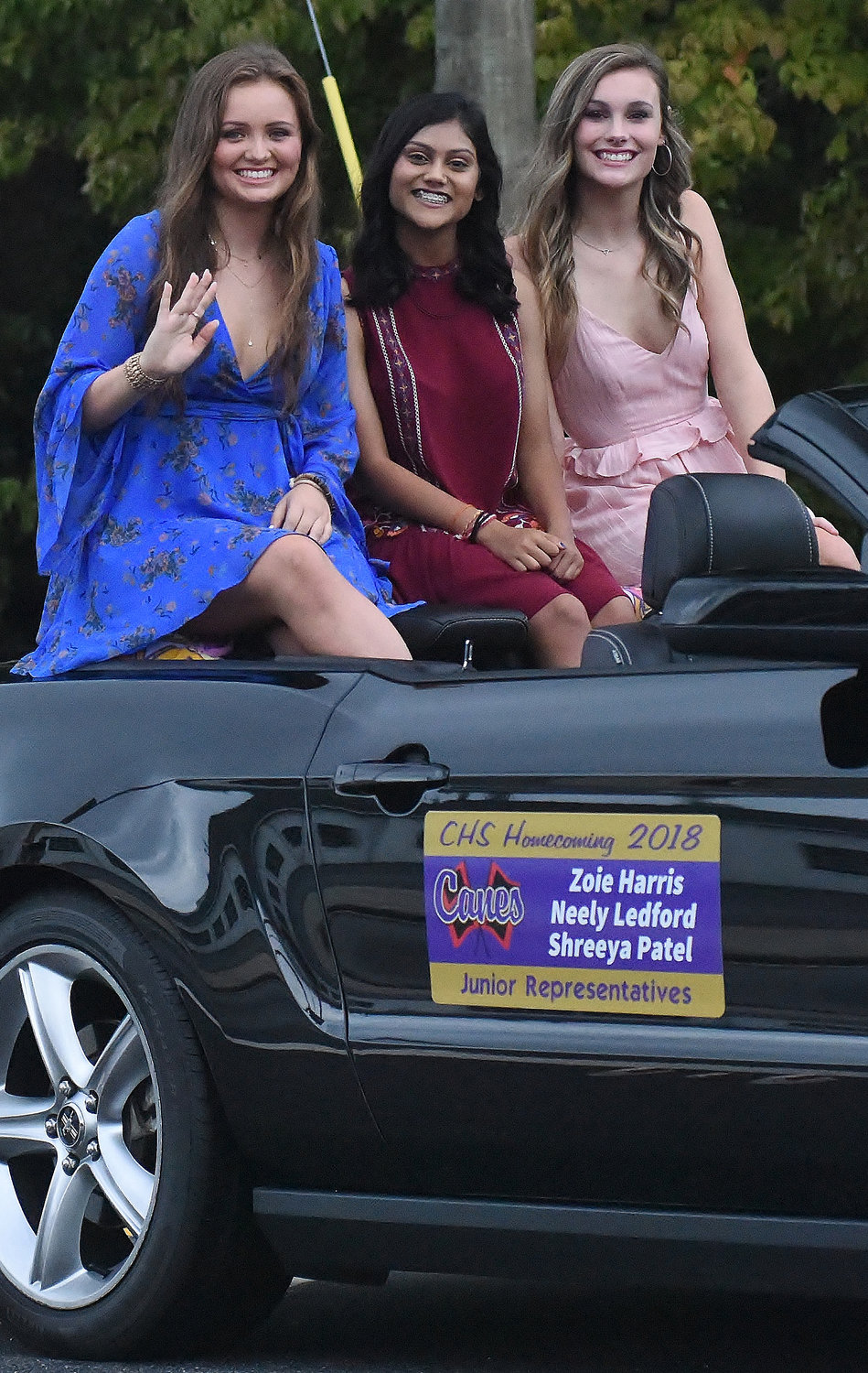 Zoie Harris, Shreeya Patel and Neely Ledford represent the Junior Class during the CHS Homecoming parade Thursday.