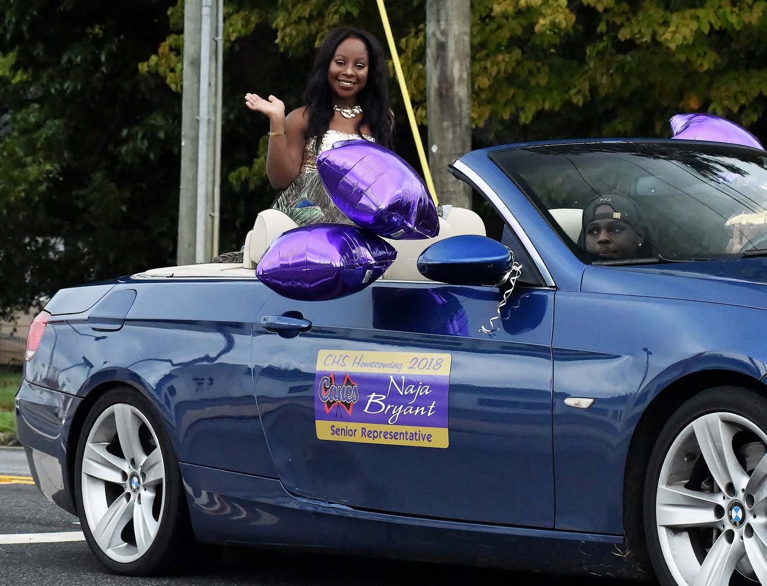 Homecoming Court senior representative Naja Bryant waves as she rides in the 2018 CHS homecoming parade.