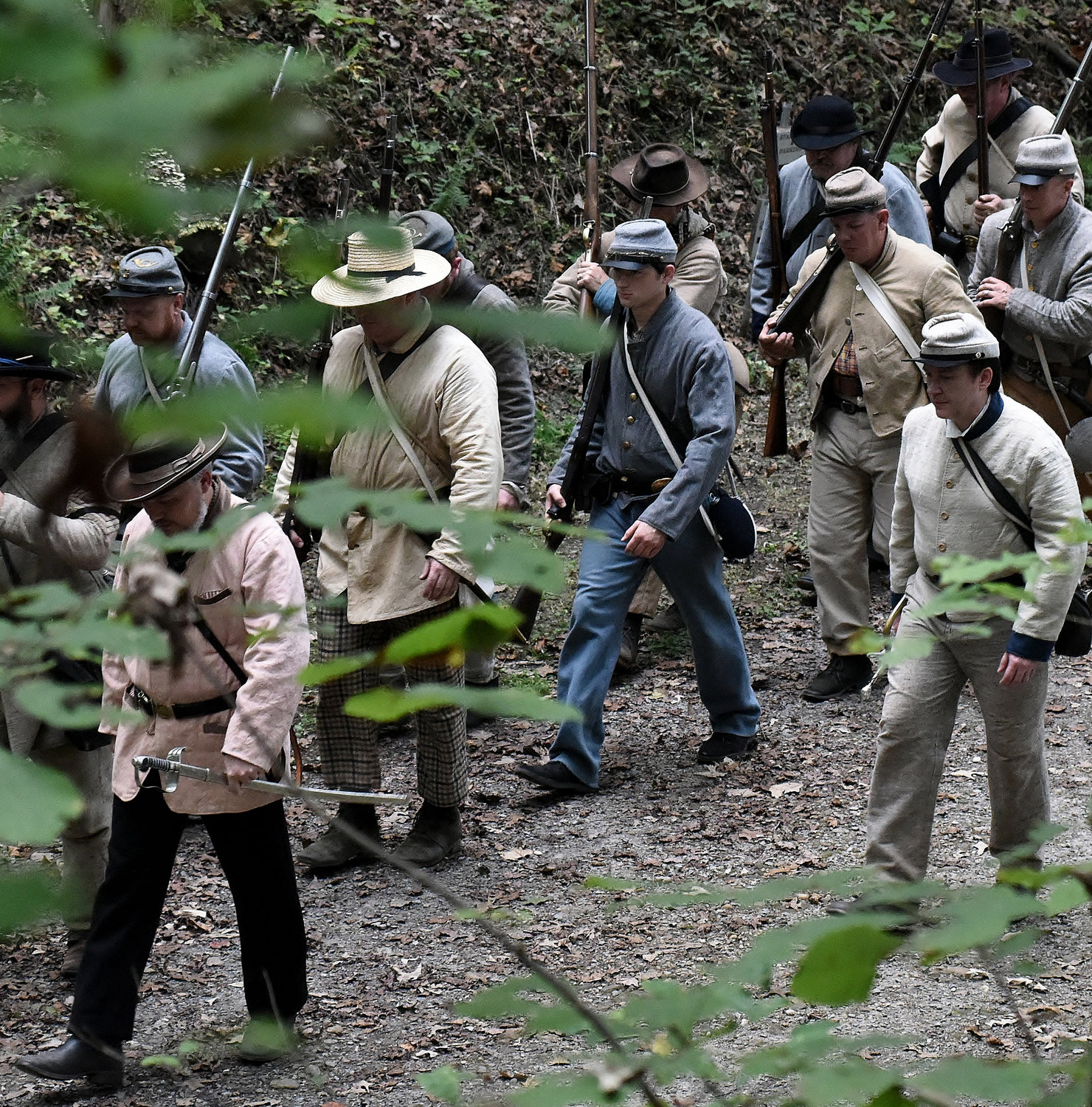 Reenactors march along a wooded trail in south Bartow County to commemorate the 154th anniversary of the Battle of Allatoona Pass Saturday.