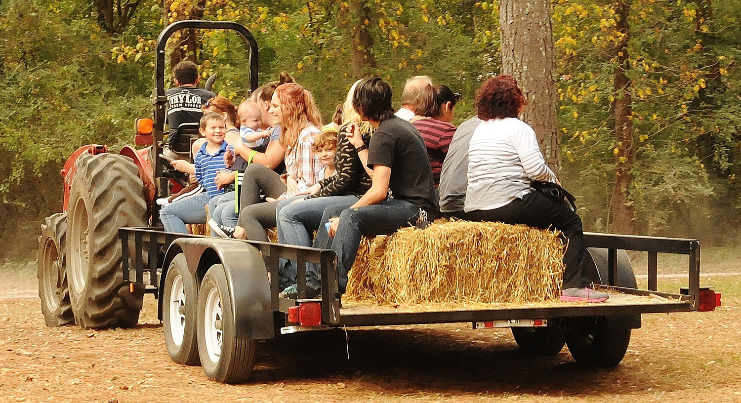 Children and adults alike enjoy the hayride at a previous Euharlee Covered Bridge Fall Festival at Frankie Harris Park.