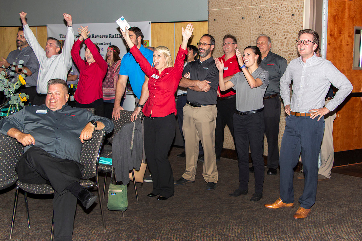 Employees of Yanmar USA celebrate after being announced the winner of the $5,000 grand prize at Chattahoochee Tech Foundation's 2018 Reverse Raffle Thursday at Chattahoochee Technical College's North Metro campus in Acworth.