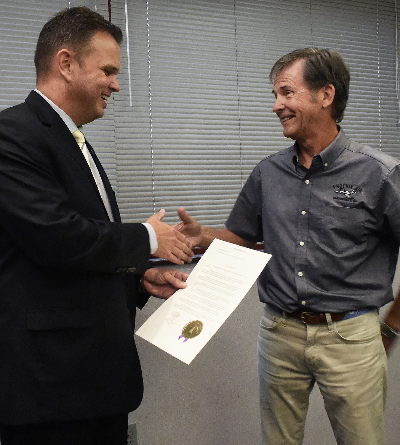 "Former State Representative Christian Coomer presented a proclamation from the Georgia House of Representatives honoring the oldest driver to ever start a Daytona 500 stock car race. Mark Thompson, founder and CEO of Phoenix Air, began racing in 1991 in the Automobile Racing Club of America series. In 2015, the-then 63-year-old won the pole position â?? the no.1 starting position â?? for ARCA's season-opening race, the oldest pole winner for any Daytona race. At age 66, Thompson drove his No. 66 Ford to a 22nd place finish in the ""Great American Race."" House Resolution 1638, sponsored by former Bartow representatives Coomer and Paul Battles, lauded Thopmpson for his effort saying, ""his extraordinary resilience and courage have brought special recognition to the State of Georgia."""