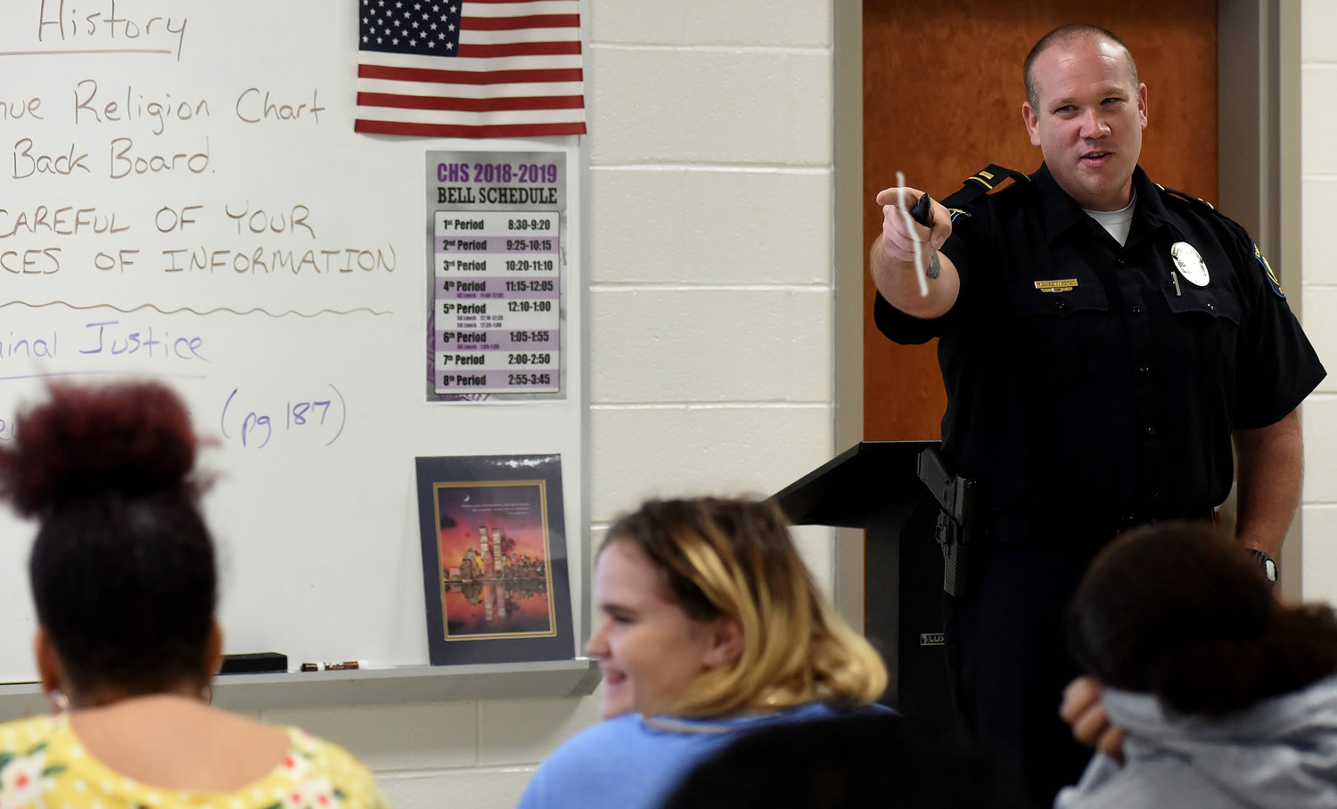 Lt. Mike Bettikofer of the Cartersville Police Department answers a student's question in Cartersville High School's criminal justice class Friday morning.
