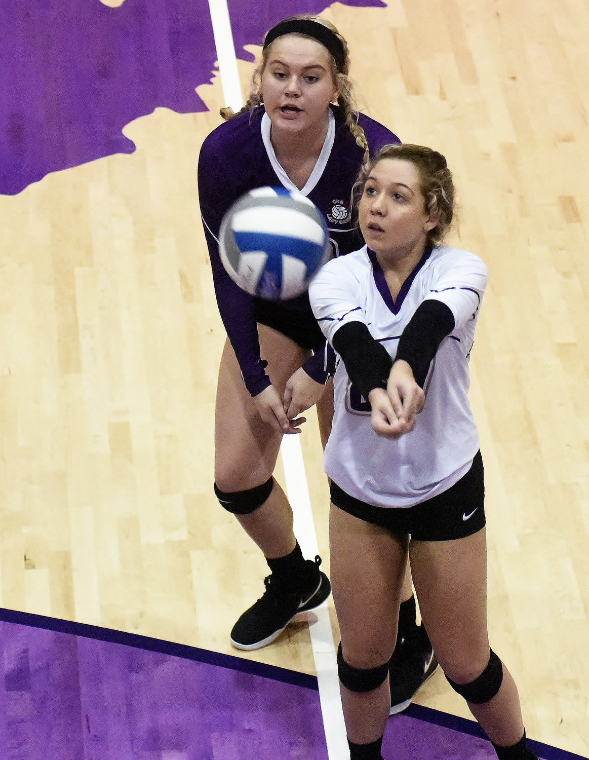 Cartersville libero Anna Mathis looks to pass the ball, as teammate Rebekah Stevens looks on, during Wednesday's Class 4A state playoff second-round match against LaFayette at The Storm Center. The Canes will host St. Pius X in the semifinals at 6 tonight.