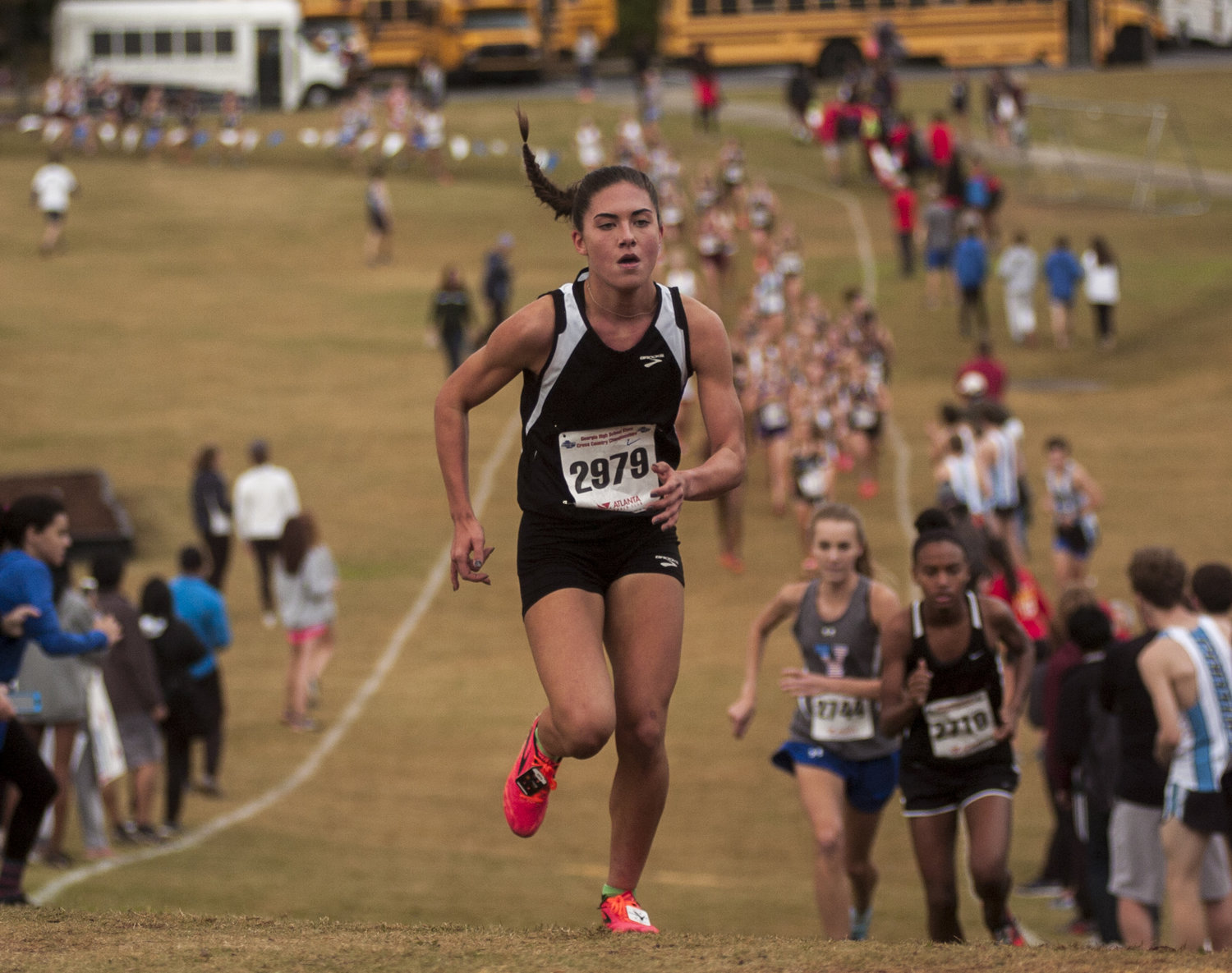 McKenna Trapheagen leads a long line of competitors Friday morning in the GHSA Class 5A state girls cross country championship in Carrollton.