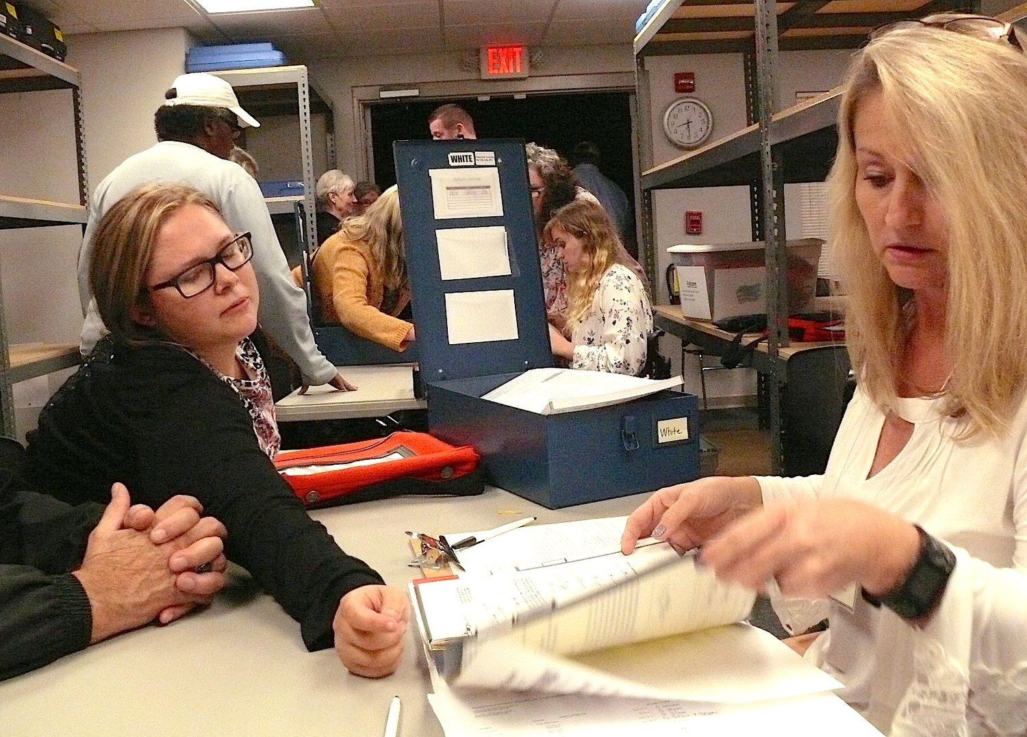 Poll officer Lisa Sanford checks in supplies from the White polling place after Tuesday's mid-term election.