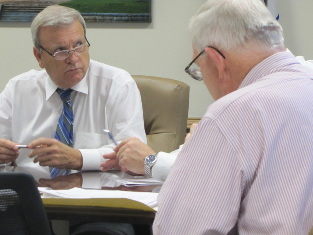 Bartow County Commissioner Steve Taylor, left, speaks with Bartow County Transportation Planner Tom Sills at Wednesday's Cartersville-Bartow Metropolitan Planning Organization meeting.