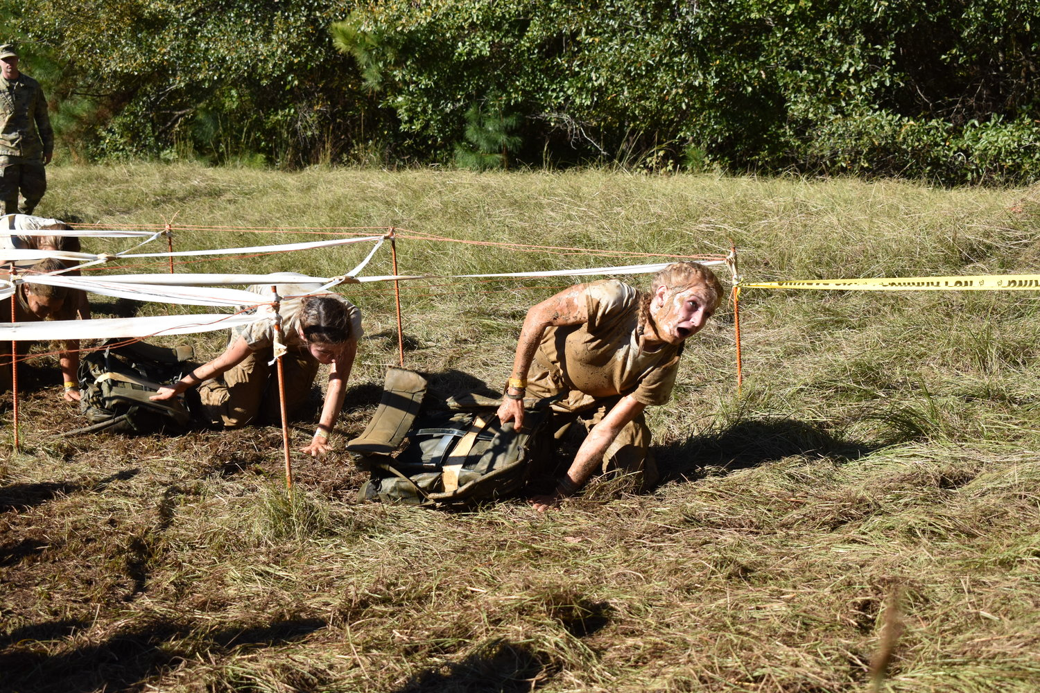 Adairsville High female Raider Megan Wimpy comes out of the low crawl at the end of the Cross Country Rescue event during Saturday's National Raider Championships in Molena.