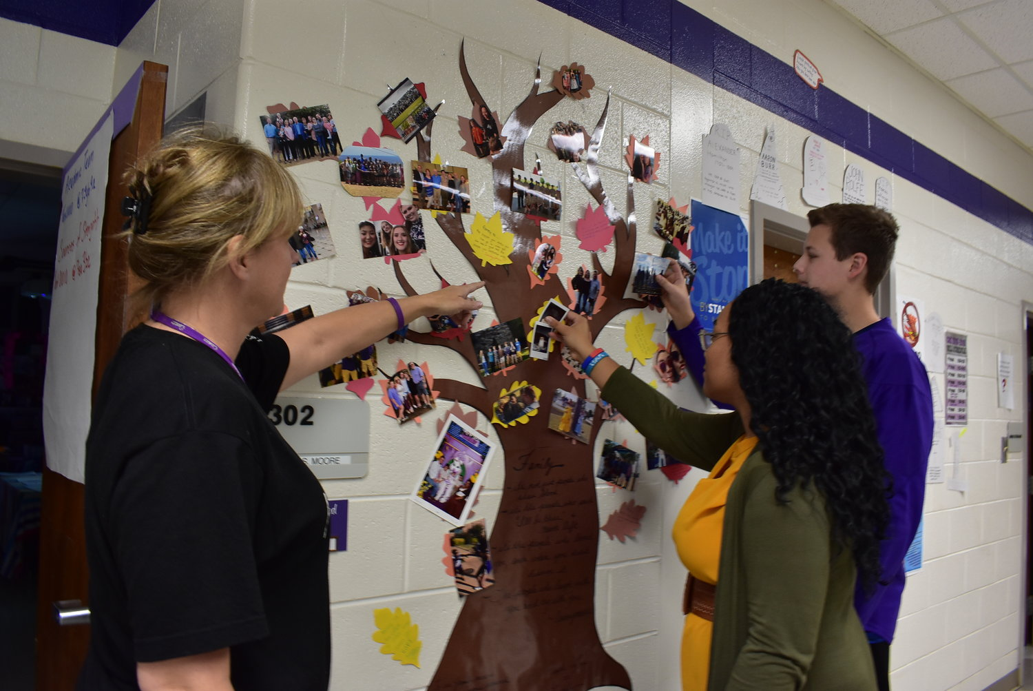 Cartersville High social studies teacher Melissa Moore, left, and students Jayla Cunningham and Logan Cagle work on the family tree project the school is doing as part of the Sources of Strength suicide prevention program.