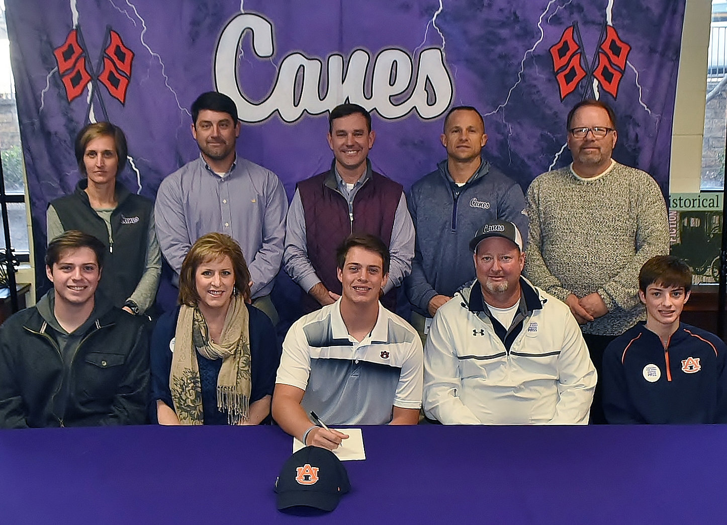 On Wednesday, Cartersville High senior Mason Barnett celebrated the signing of his national letter of intent to play baseball at Auburn. On hand to join him were, from left, front row: Miller Barnett, brother; Merrie Barnett, mother; Greg Barnett, father; Andy Barnett, brother; back row, Shelley Tierce, CHS principal; Brandon Patch, CHS assistant baseball coach; Kyle Tucker, CHS head baseball coach; Corey Gochee, CHS assistant baseball coach; and Darrell Demastus, CHS athletic director.