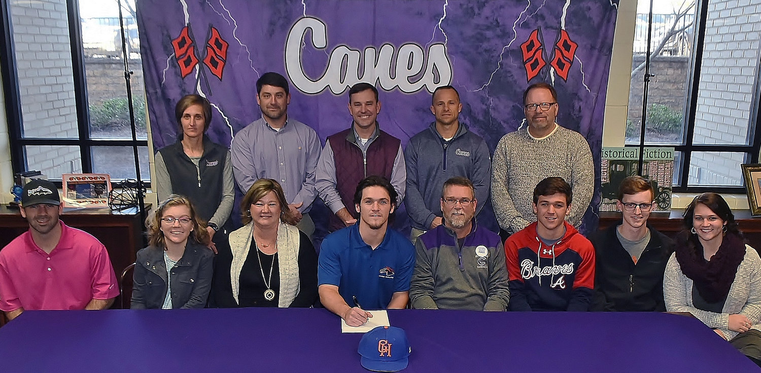 On Wednesday, Cartersville High senior J.P. Martin celebrated the signing of his national letter of intent to play baseball at Georgia Highlands College. On hand to join him were, from left, front row: Dalton Martin, brother; Hillary Martin, sister; Michelle Martin, mother; Tony Martin, father; Christian Martin, brother; Logan Bagley, brother-in-law; Anna Bagley, sister; back row, Shelley Tierce, CHS principal; Brandon Patch, CHS assistant baseball coach; Kyle Tucker, CHS head baseball coach; Corey Gochee, CHS assistant baseball coach; and Darrell Demastus, CHS athletic director.