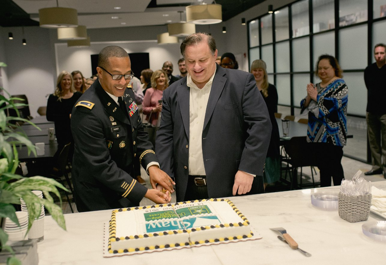 From left, U.S. Army Lt. Colonel Frederick Parker and Shaw Industries Vice President of Customer Fulfillment Kevin O'Meara celebrate the recent Partnership for Youth Success (PaYS) agreement at a Nov. 14 ceremony.
