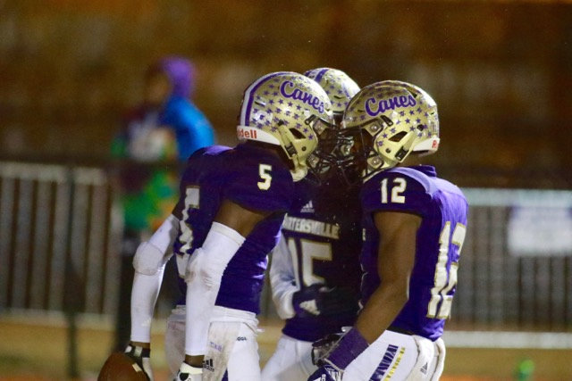 Cartersville wide receivers, from left, Devonte Ross, Trendon Horton and Dadrian Dennis celebrate one of Ross' touchdowns during Friday's Class 4A state semifinal win over Marist.