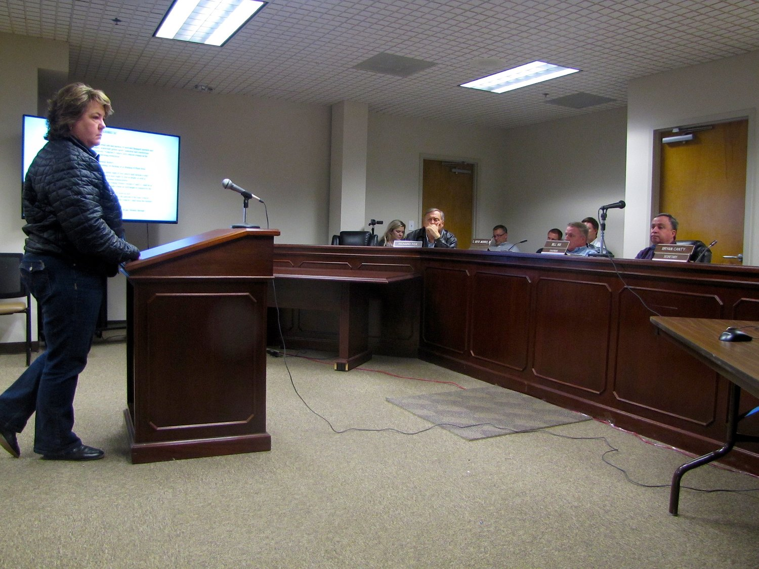 Copart of Georgia Operations Manager Joyce Benedict takes the podium at Monday night's Bartow County Planning Commission meeting. Although that commission voted unanimously to deny the company's request for a zoning ordinance text amendment, Copart's request was approved Wednesday by Bartow County Commissioner Steve Taylor.