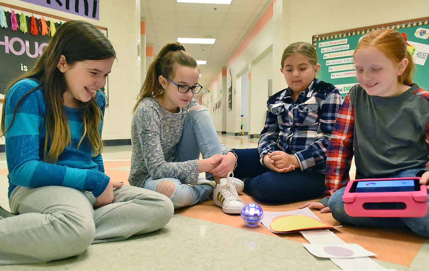Clear Creek Elementary School fifth-graders, from left, Emma Phillips, Hailie Lieving, Brianna Morris and Amelia Carter work on creating a program for their Sphero robot.