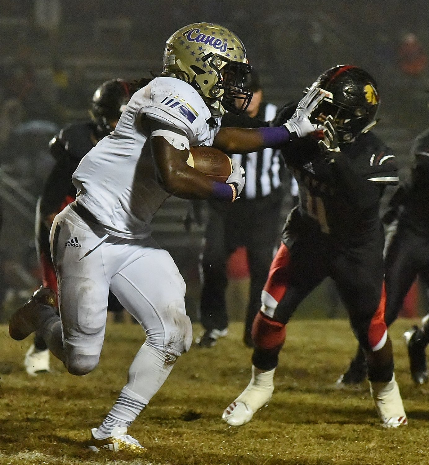 Cartersville senior Marcus Gary stiff-arms a Baldwin defender during a Class 4A state quarterfinal this past season. Gary earned all-county offensive player of the year.