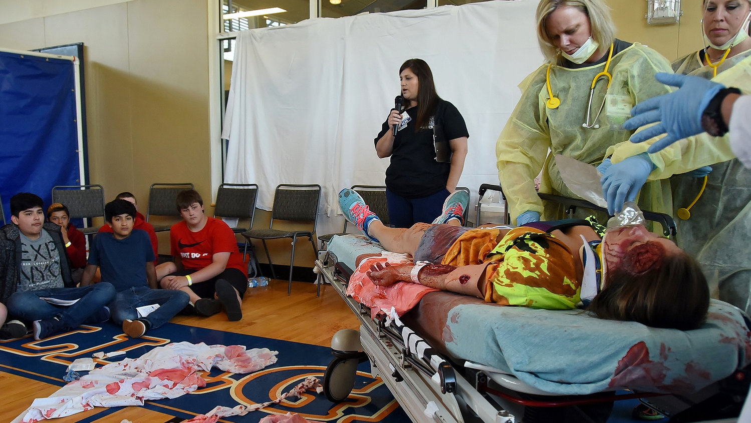 South Central Middle School eighth-graders witness the treatment of a victim of a mock auto accident at the annual Teen Maze May 10 at Georgia Highlands College.