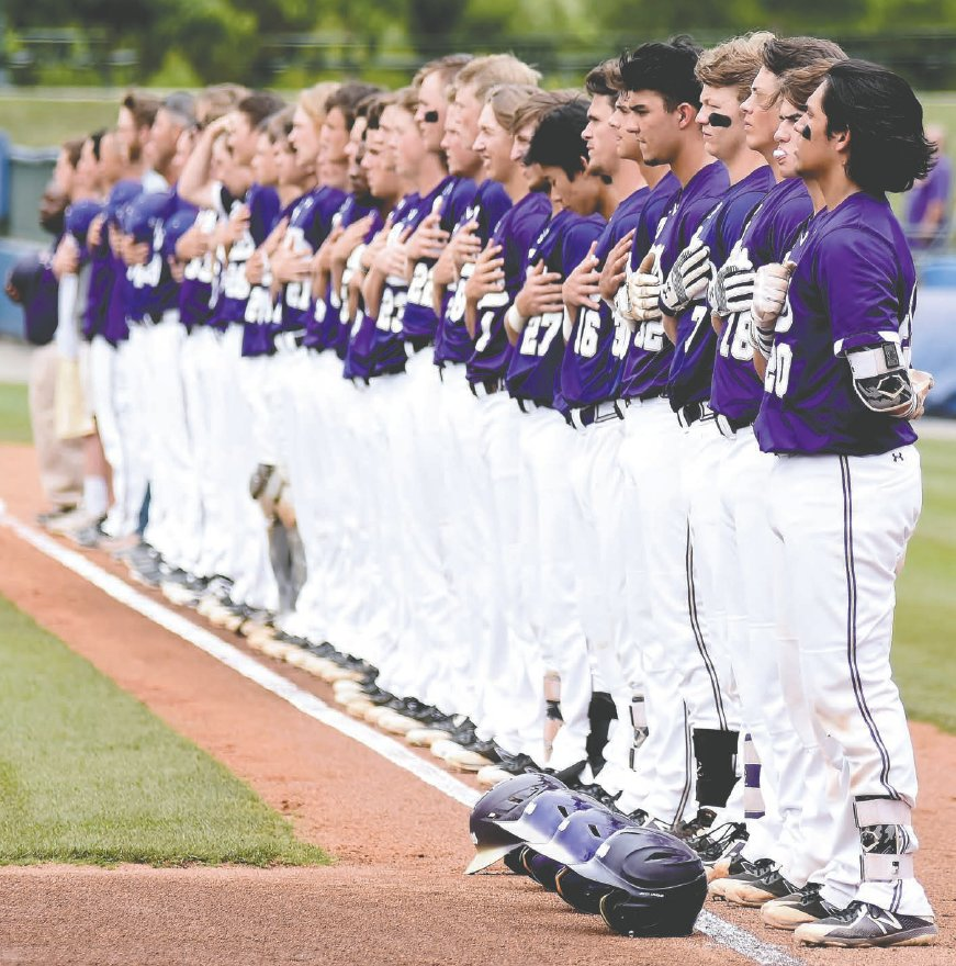 The Cartersville baseball team lines up along the first base line for the national anthem before Game 1 of the Class 4A state championship series May 21 at State Mutual Stadium in Rome.