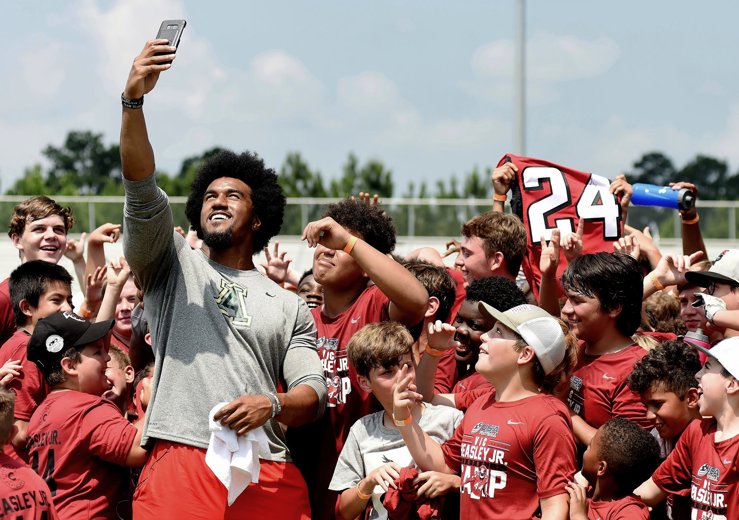 Vic Beasley Jr. gathers the participants of his football camp together for a selfie. More than 200 young football enthusiasts attended Beasley's camp at Adairsville High School on June 16.
