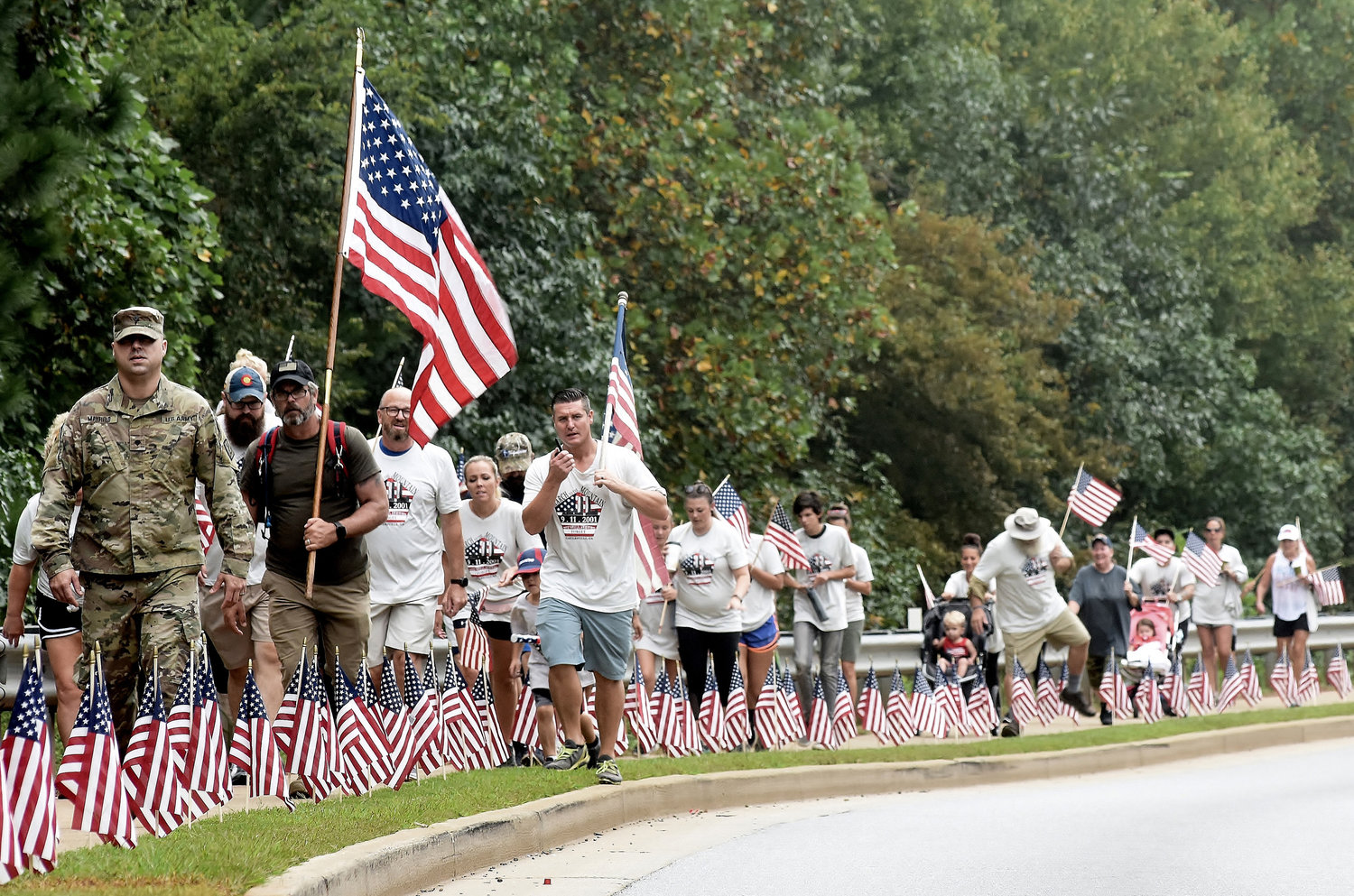 Approximately 100 men, women and children took part in the annual 9/11 March to the Mountain in Cartersville.