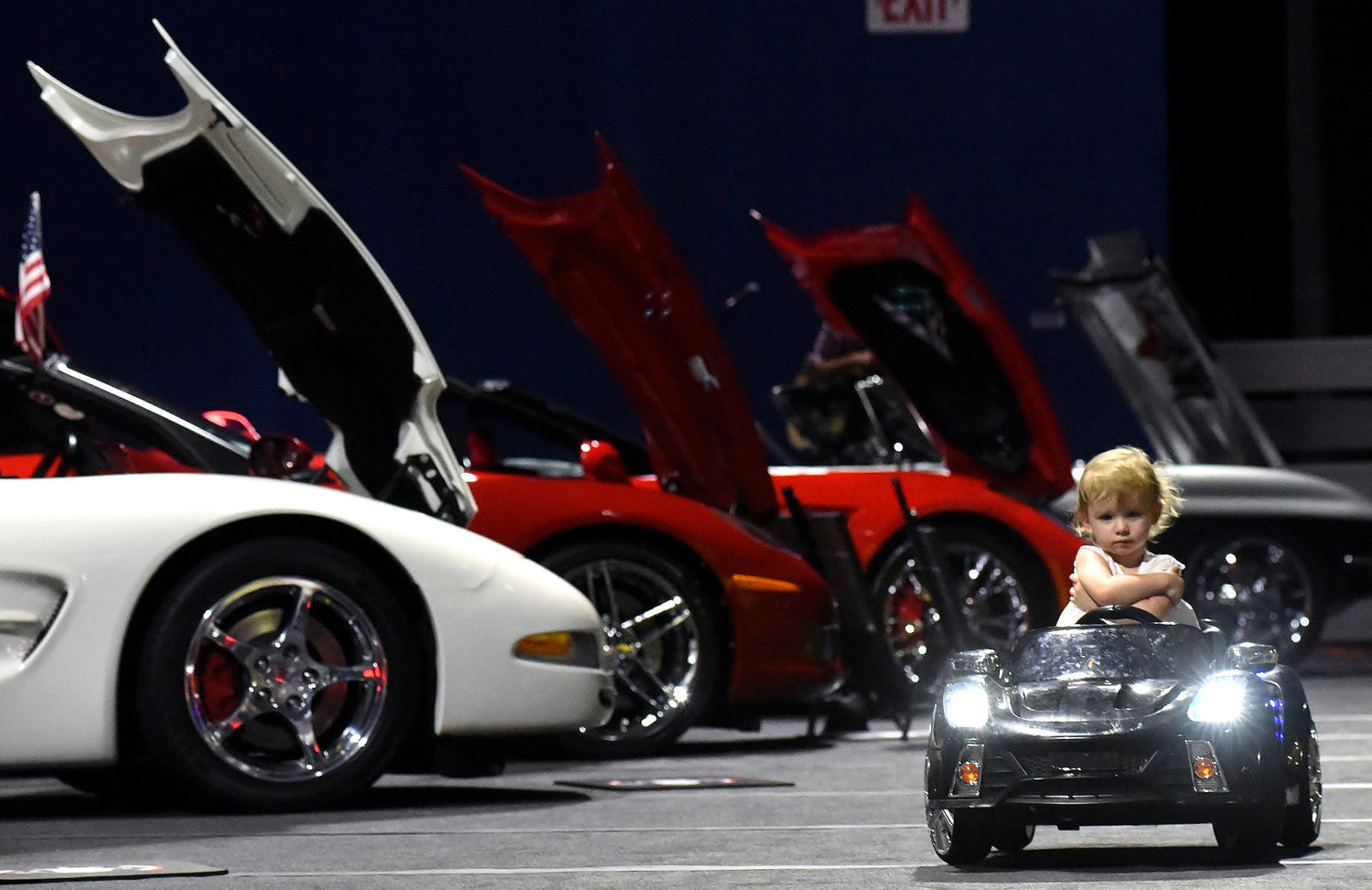 Two-year-old Amelia Barnhorn of Kennesaw cruises aisles of the My American Dream Corvette & Camaro MADness Show 2K18 at the LakePoint Champions Center Sept. 29.