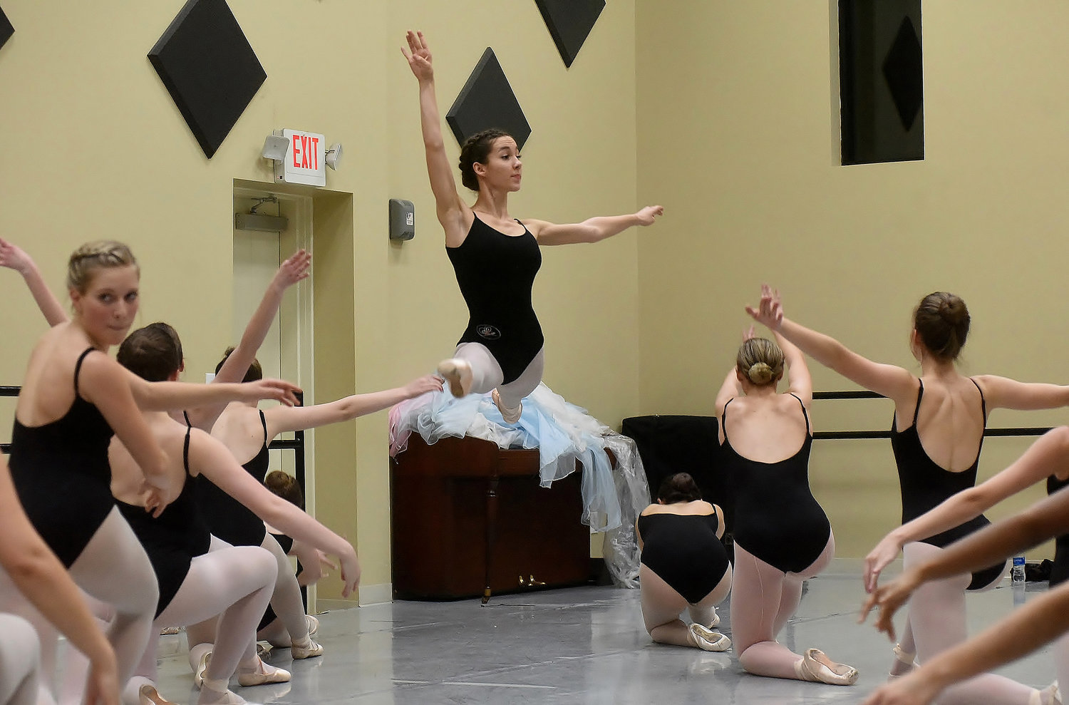 "Alayna Reece performs a grand jeta during a rehearsal session for ""The Nativity."""